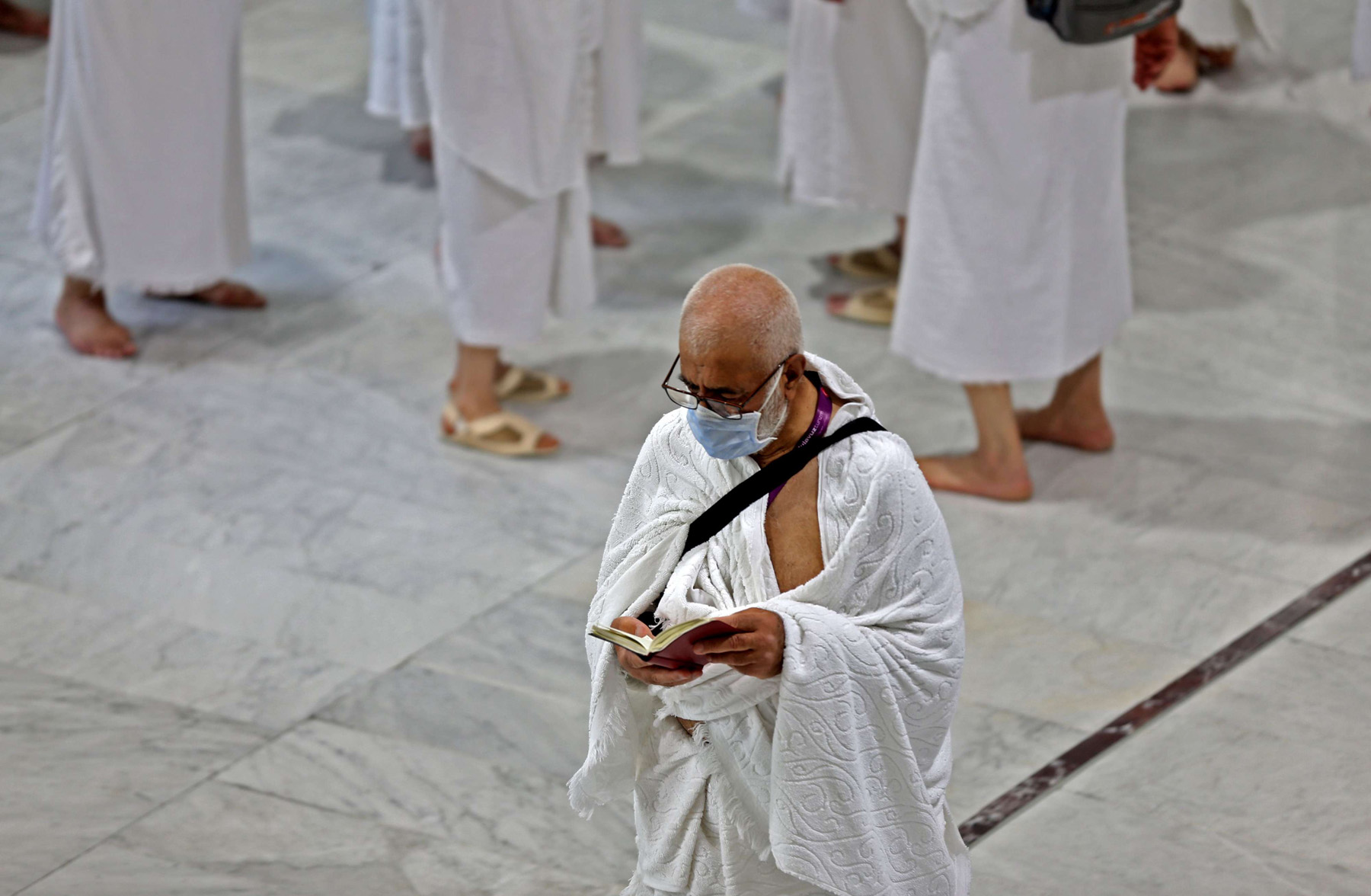 A Muslim pilgrim wears protection mask at the Grand Mosque in Mecca, February 27. (AFP)