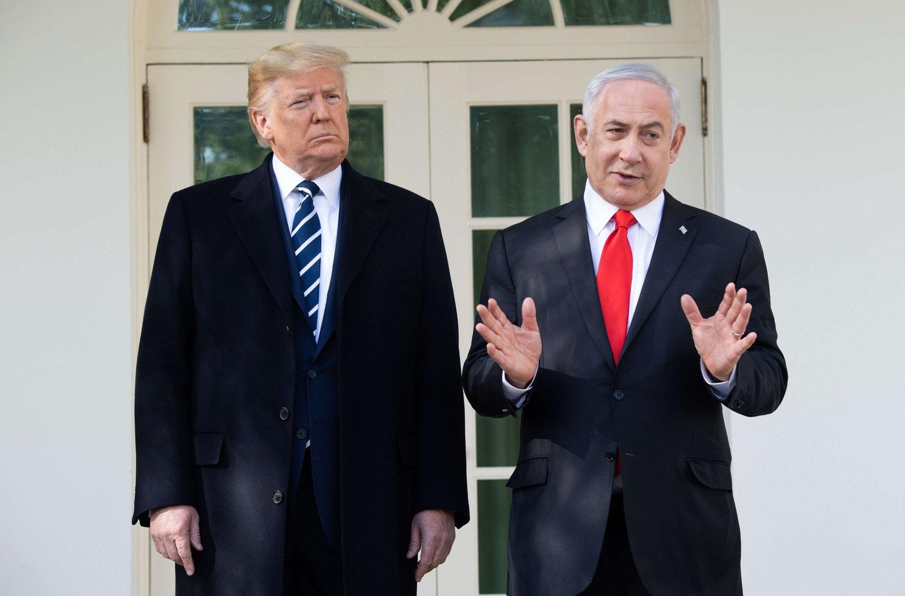 US President Donald Trump and Israeli Prime Minister Benjamin Netanyahu (R) speak to the press on the West Wing Colonnade prior to meetings at the White House in Washington, DC. (AFP)