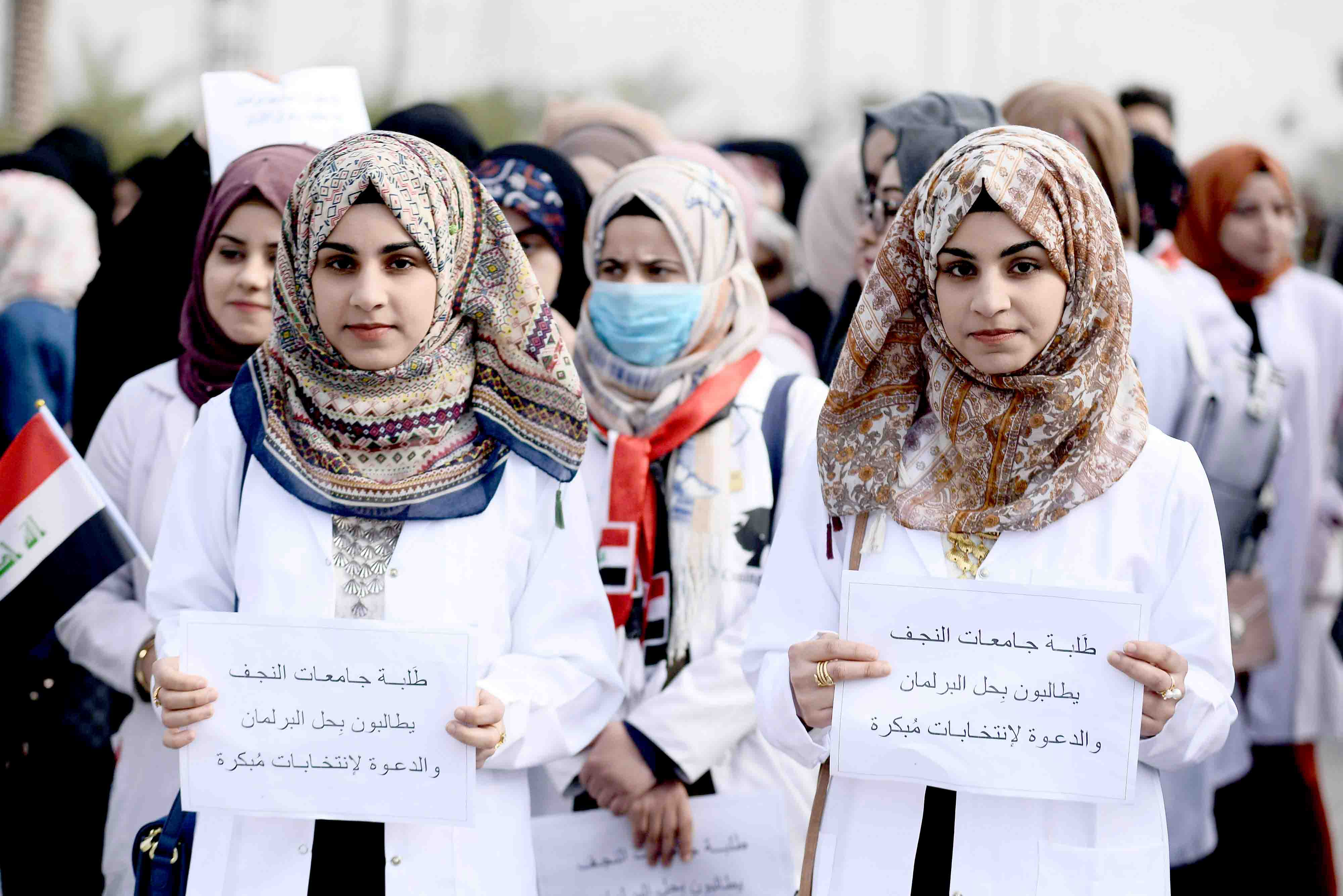 Iraqi university students take part in an anti-government demonstration in the city of Najaf, December 29. (AFP)