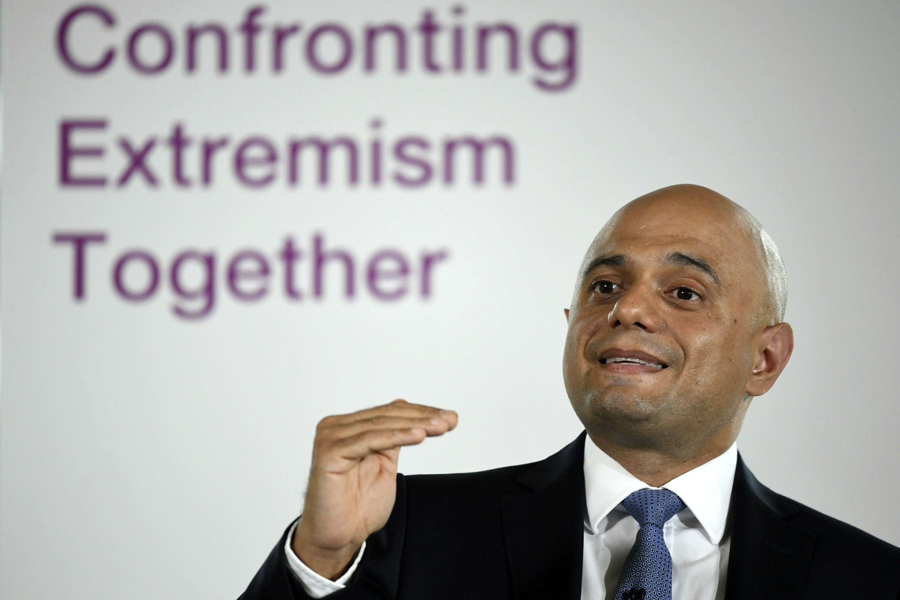 Britain's Home Secretary Sajid Javid makes a speech, in central London, to warn that excessive language is spreading hate and working people into a frenzy. July 19, 2019 (AP)