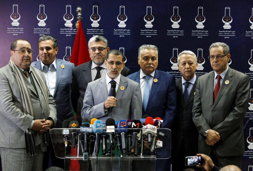 A 2017 file picture shows Morocco's Prime Minister Saad Eddine El Othmani (C) giving a news conference next to Moroccan party leaders including Driss Lachgar (L) of the Socialist Union of Popular Forces party (USFP). (REUTERS)