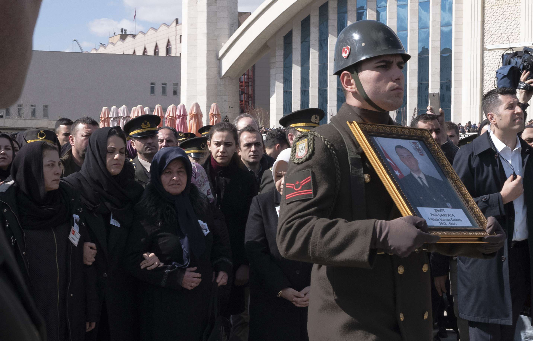 Family members attend a funeral ceremony in Ankara, March 1, for one of the Turkish soldiers killed in Idlib. (AP)