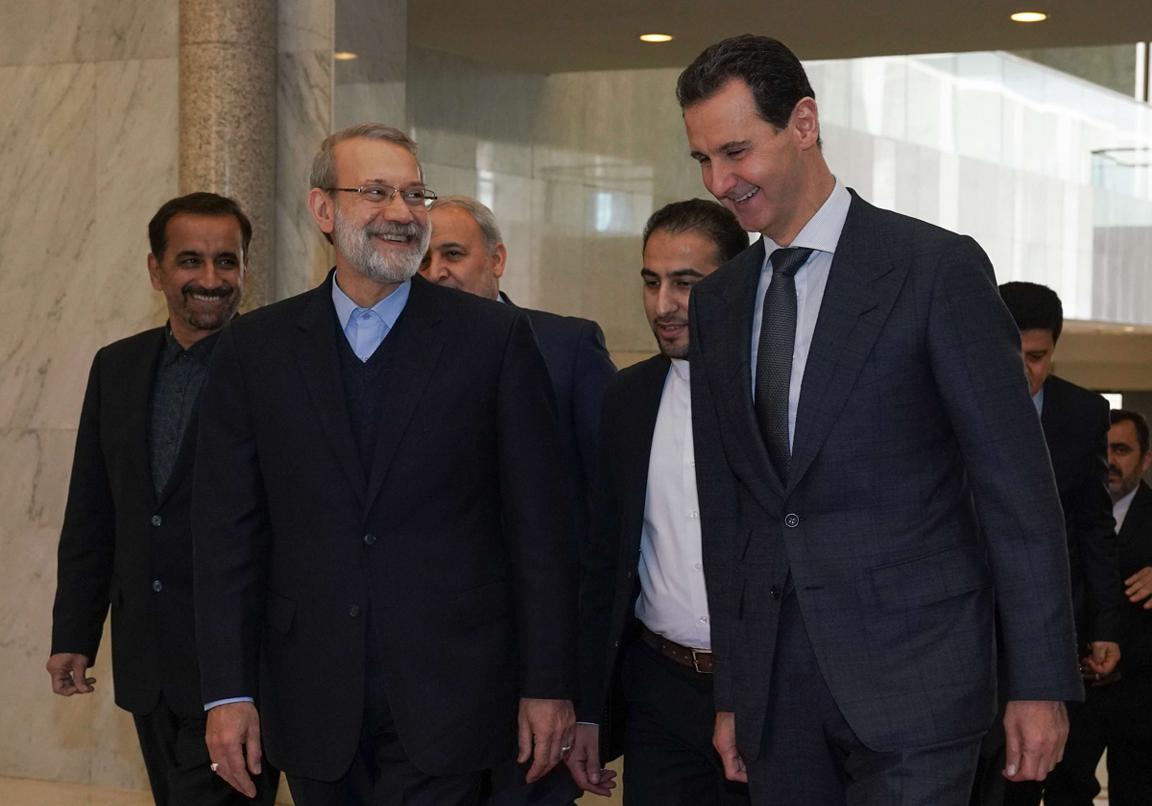 In this photo released by the Syrian official news agency SANA, Syrian President Bashar Assad, right, speaks to Iran's Parliament Speaker Ali Larijani, in Damascus, Syria, Sunday, Feb. 16, 2020. (AP)