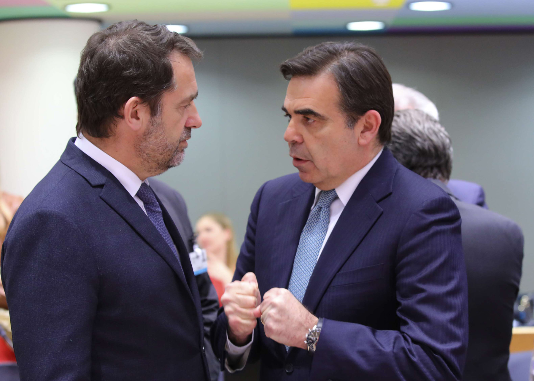 European Commissioner, Margaritas Schinas (R) speaks with French Interior Minister Christophe Castaner during a meeting of EU Interior Ministers in Brussels, March 4. (AP)