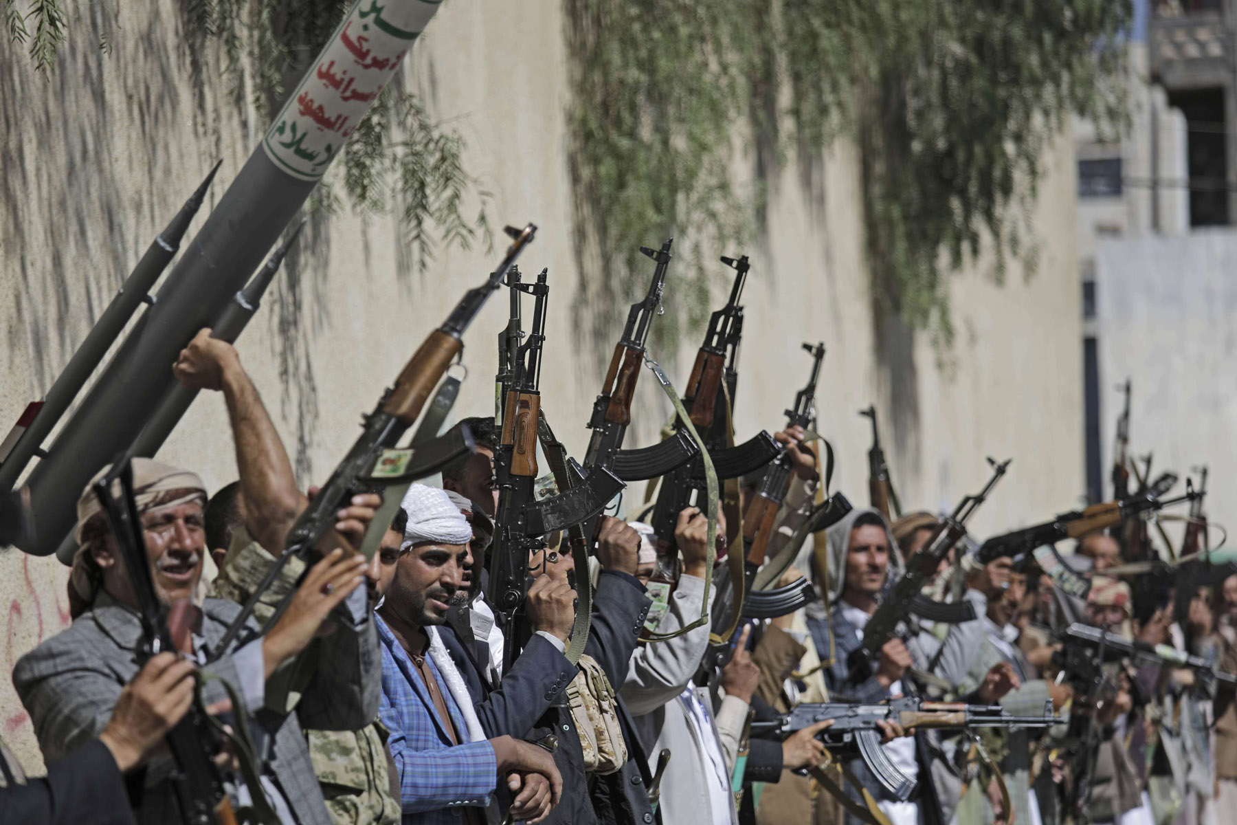 Tribesmen loyal to Houthi rebel raise their weapons during a gathering aimed at mobilizing more fighters for the Houthi movement, in Sanaa, Yemen,  Feb. 25, 2020. (AP)
