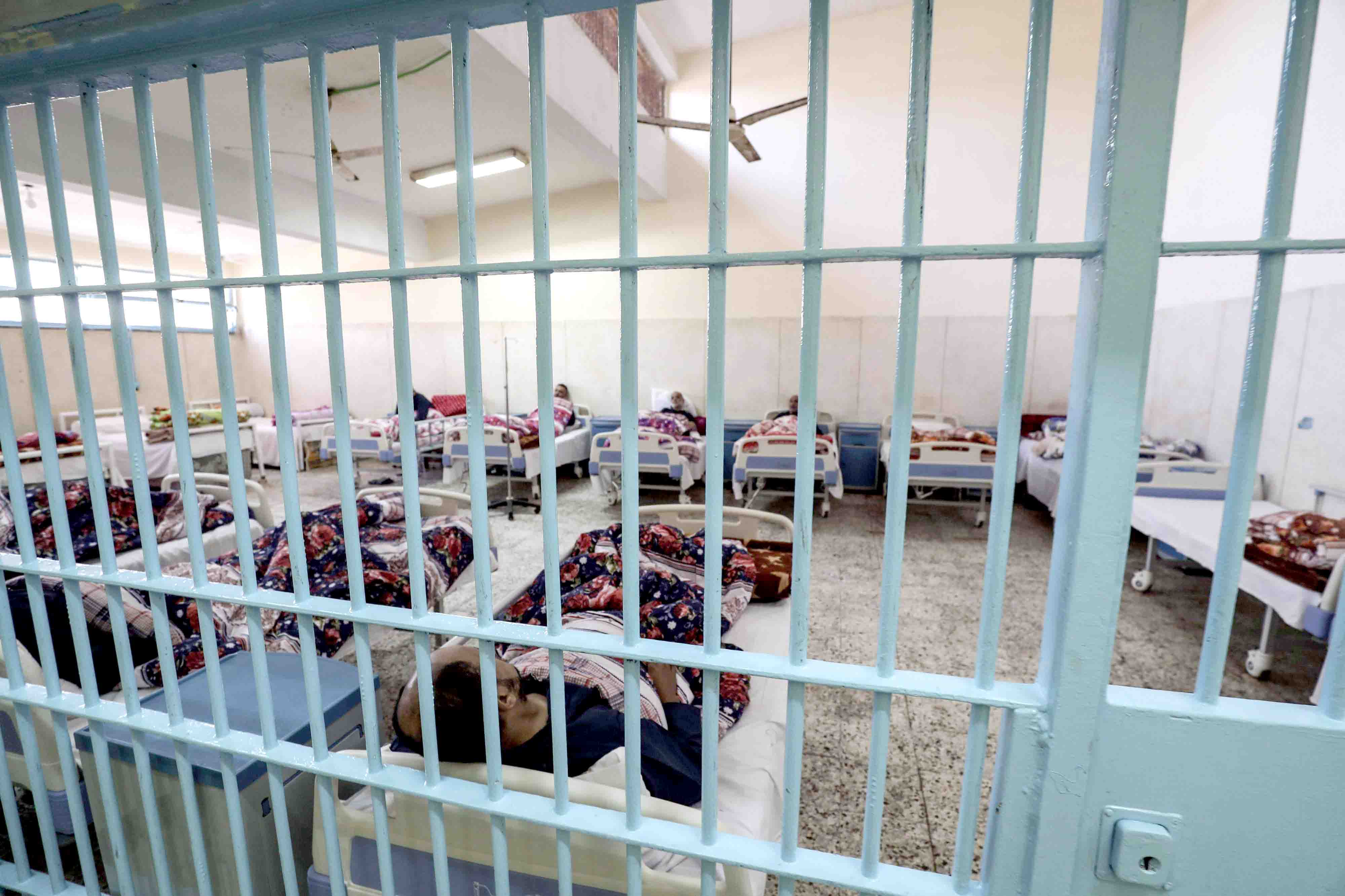 A picture taken during a guided tour organised by the Egyptian State Information Service shows inmates receiving medical treatment at the clinic of Borg el-Arab Prison near  Alexandria, November 20, 2019. (AFP)