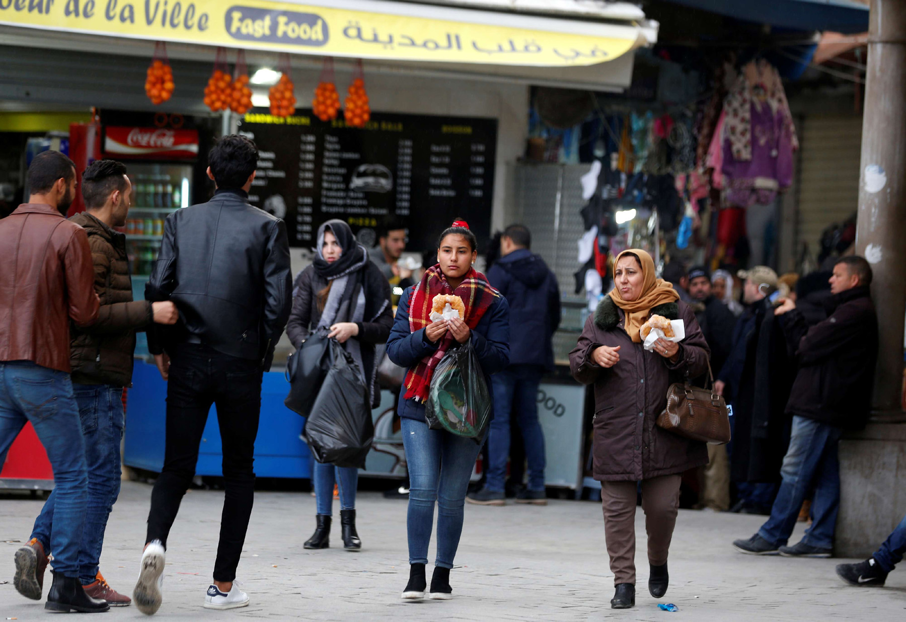 People walk at the Kasbah souk in the old town of Tunis, March 10. (AFP)