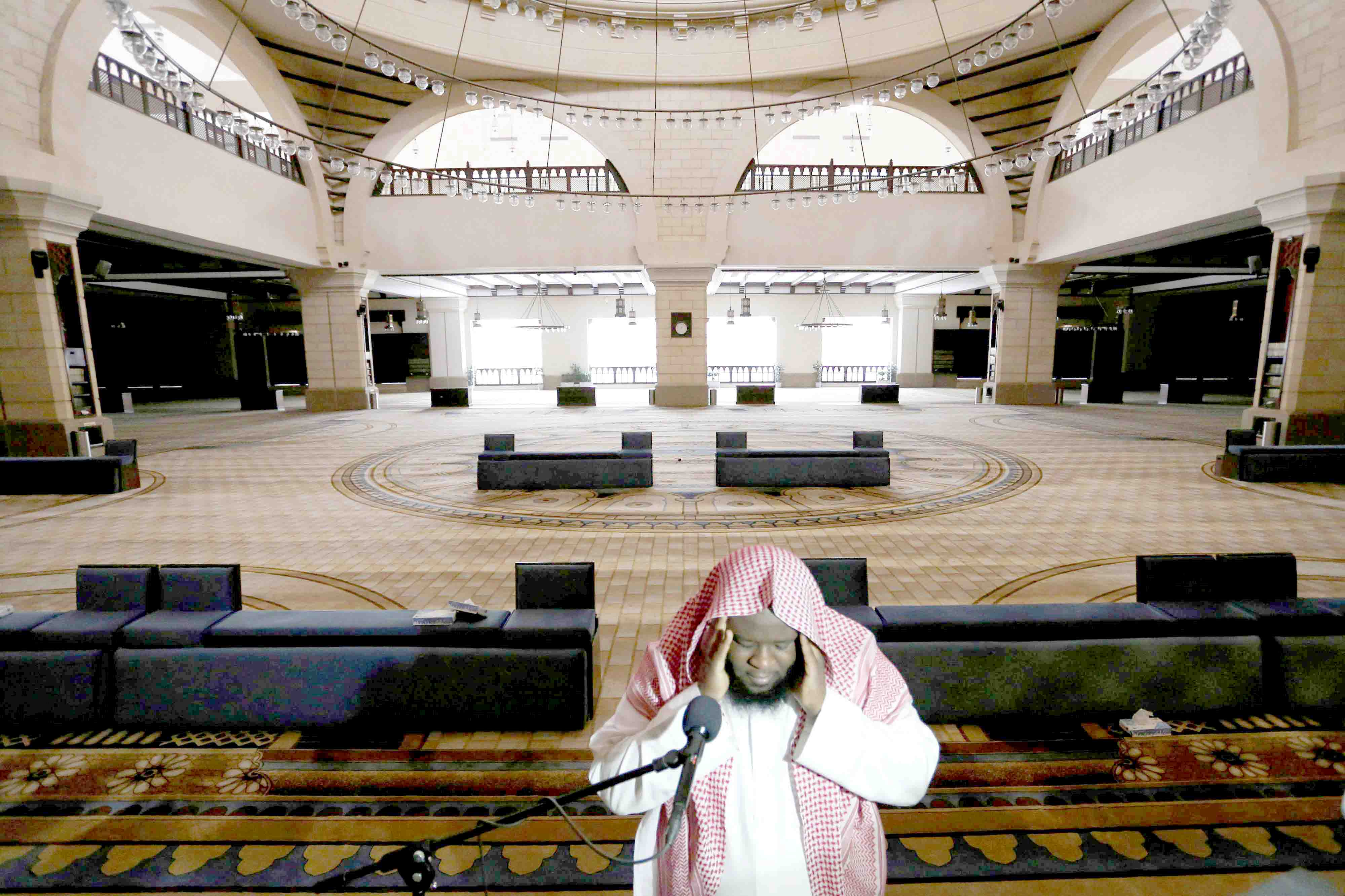 A cleric calls for the prayer at an empty Al-Rajhi Mosque after Friday prayers were suspended following the spread of the coronavirus in Riyadh, March 20. (Reuters)