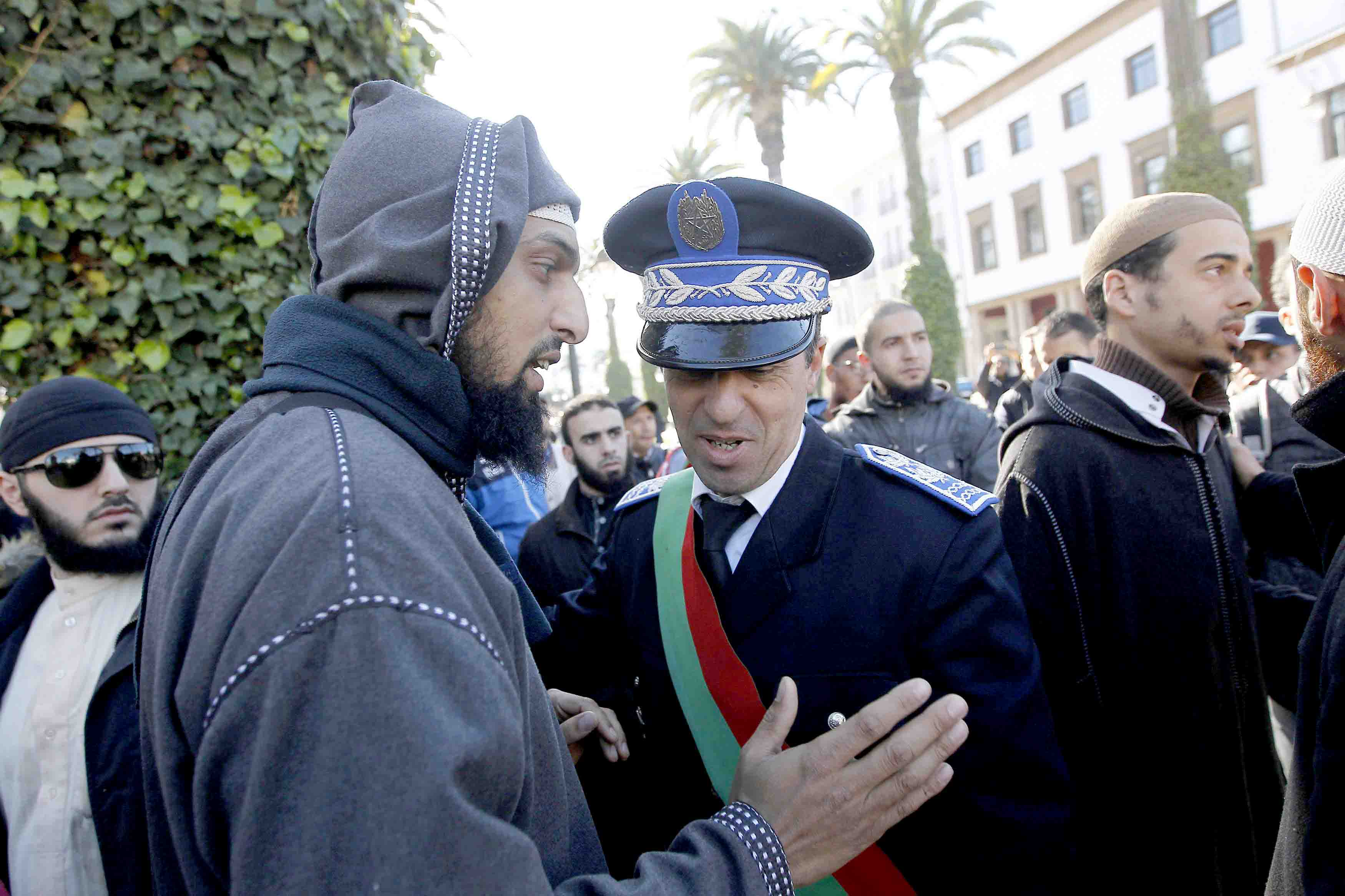 A 2017 file picture shows a Salafist protester talking to a police officer during a demonstration against the ban on the sale and manufacturing of the burqa in Rabat. (Reuters)