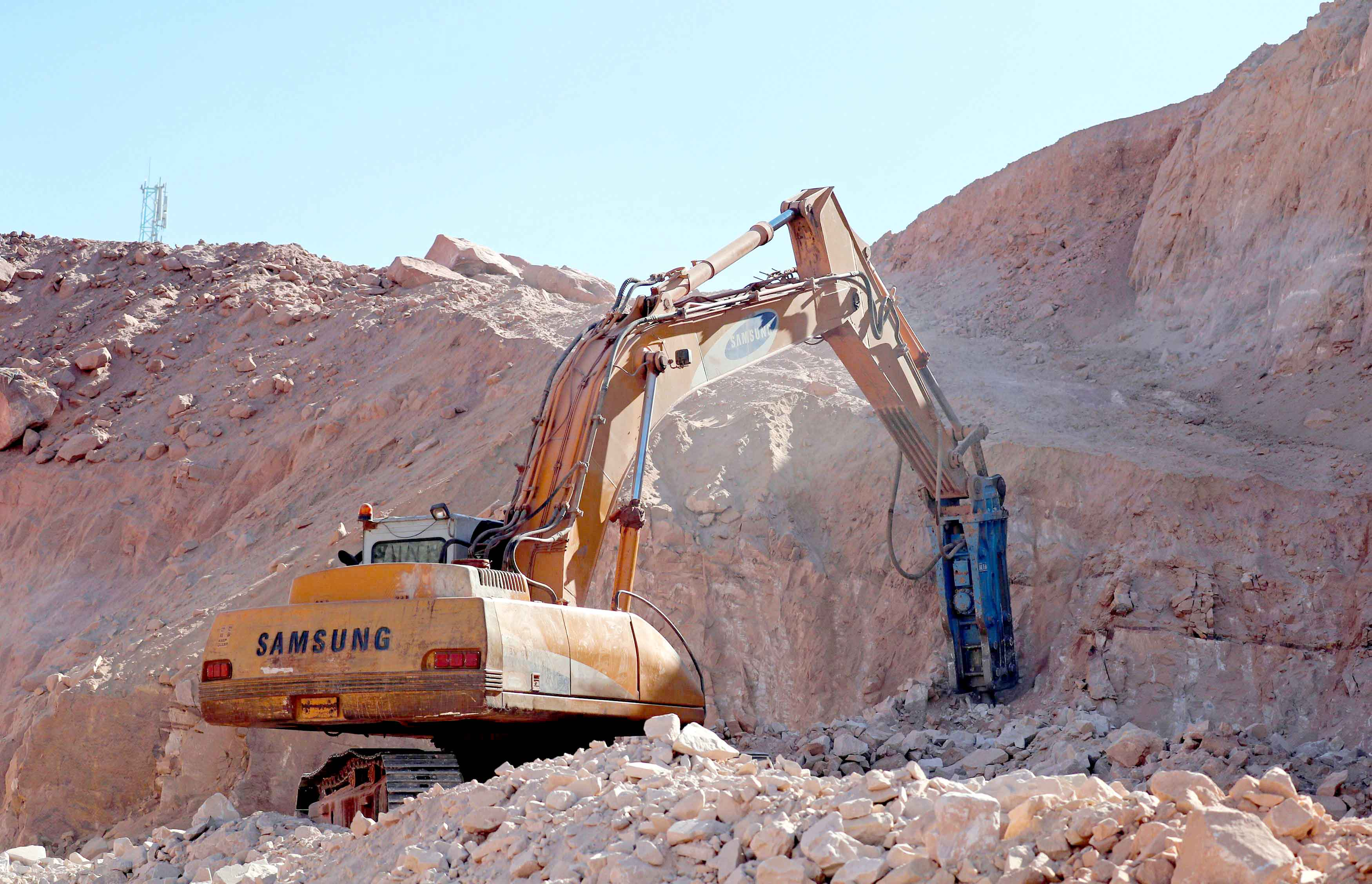 A worker uses a digger on the new road to Saint Catherine, in the Sinai Peninsula, south of Cairo. (Reuters)