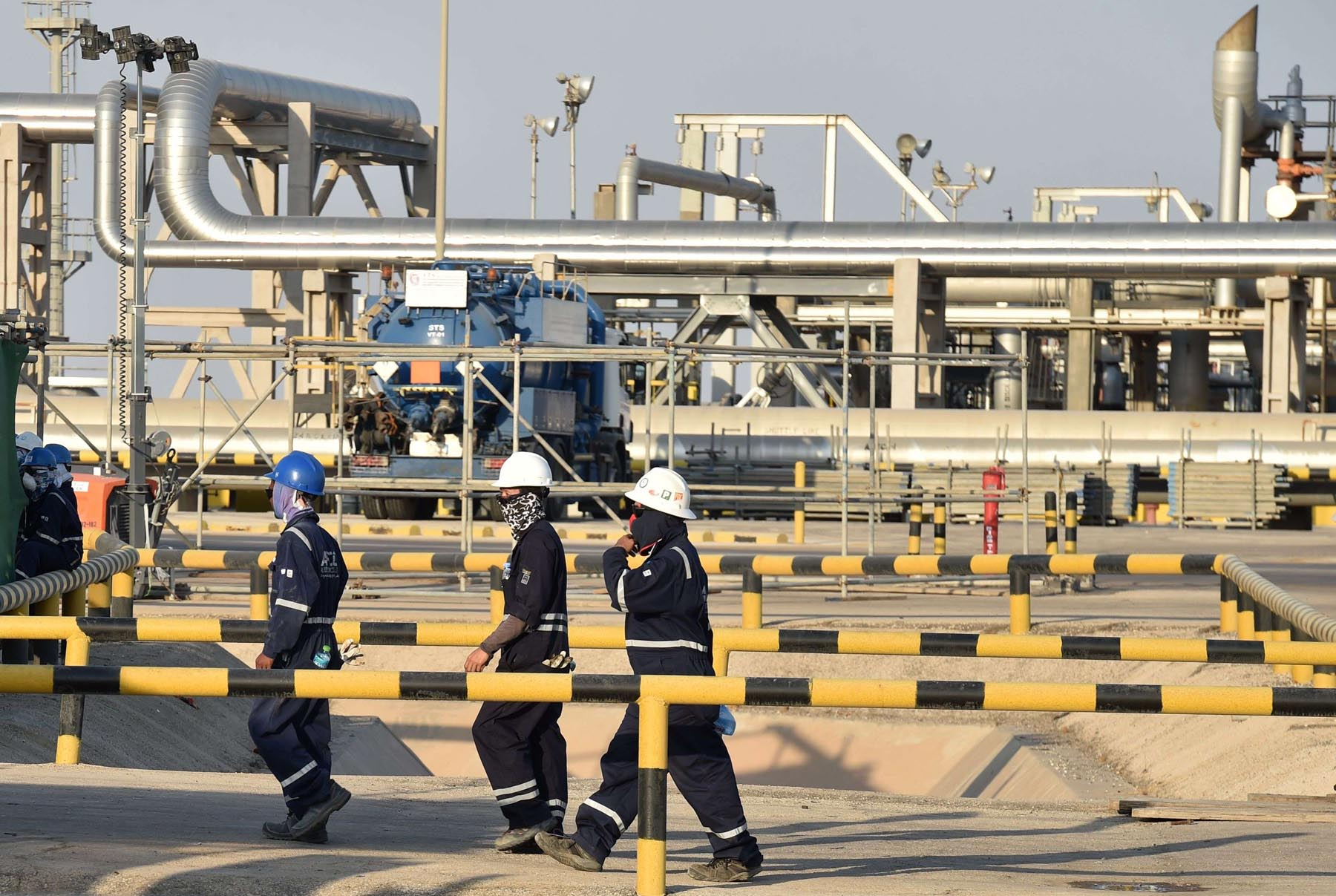 Employees of Aramco oil company at Saudi Arabia's Abqaiq oil processing plant. (AFP)
