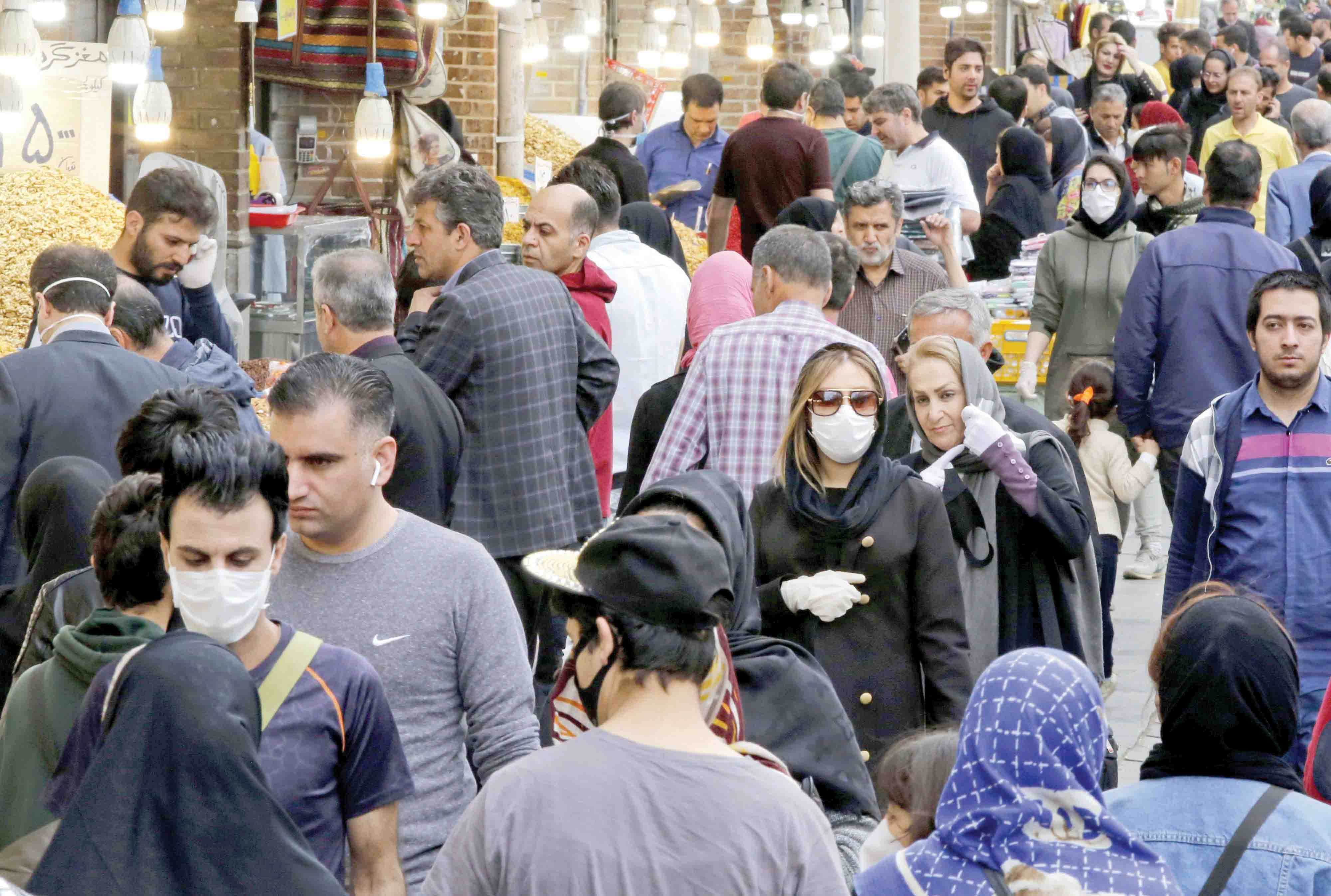 A crowd of  Iranians, some only wearing protective masks, at Tehran's grand bazaar, despite the COVID-19 coronavirus pandemic. (AFP)