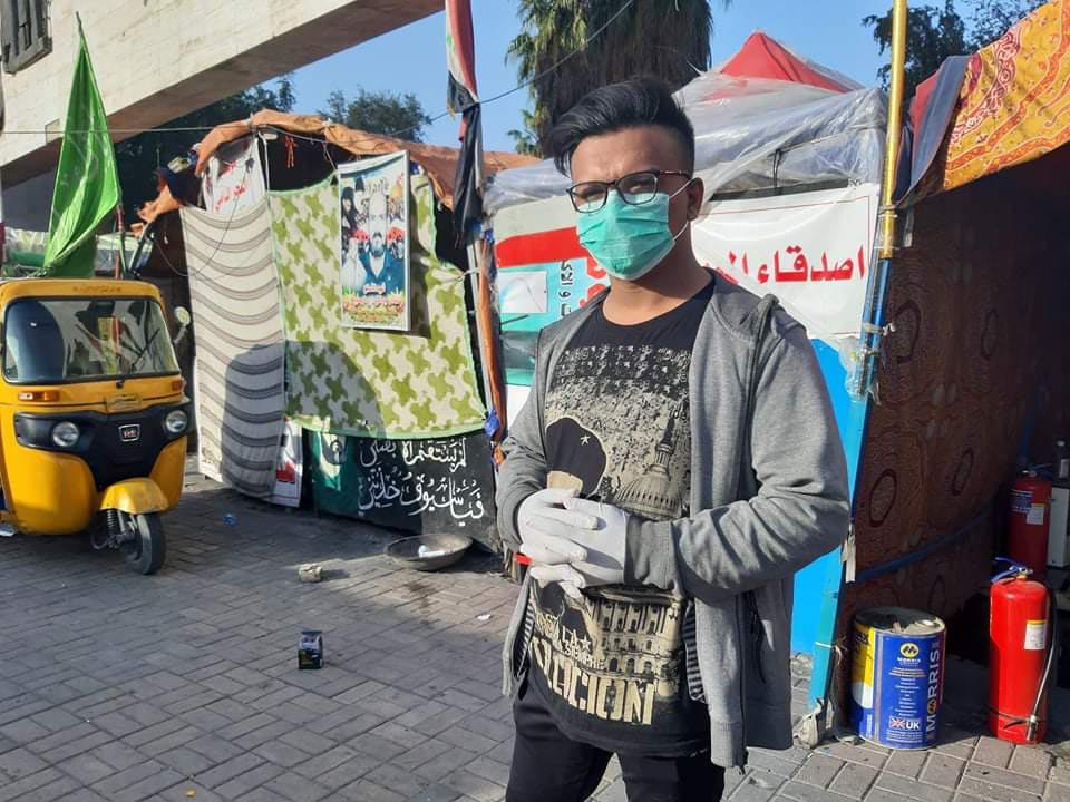 A protester outside a tent in Tahrir Square in Baghdad. (Oumayma Omar)