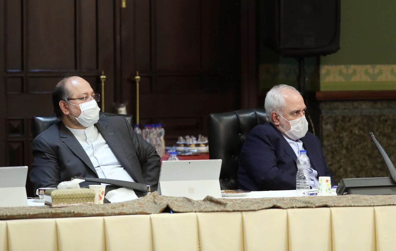 Iranian Foreign Minister Mohammad Javad Zarif (R) wears a face mask as he attends a meeting of the Iranian government task force on the coronavirus, in Tehran, March 21. (Reuters)