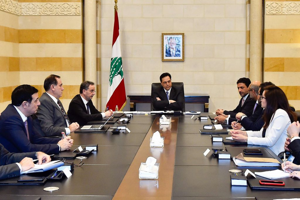 Lebanese Prime Minister Hassan Diab (C) meets with a delegation from the International Monetary Fund in Beirut, last February. (DPA)