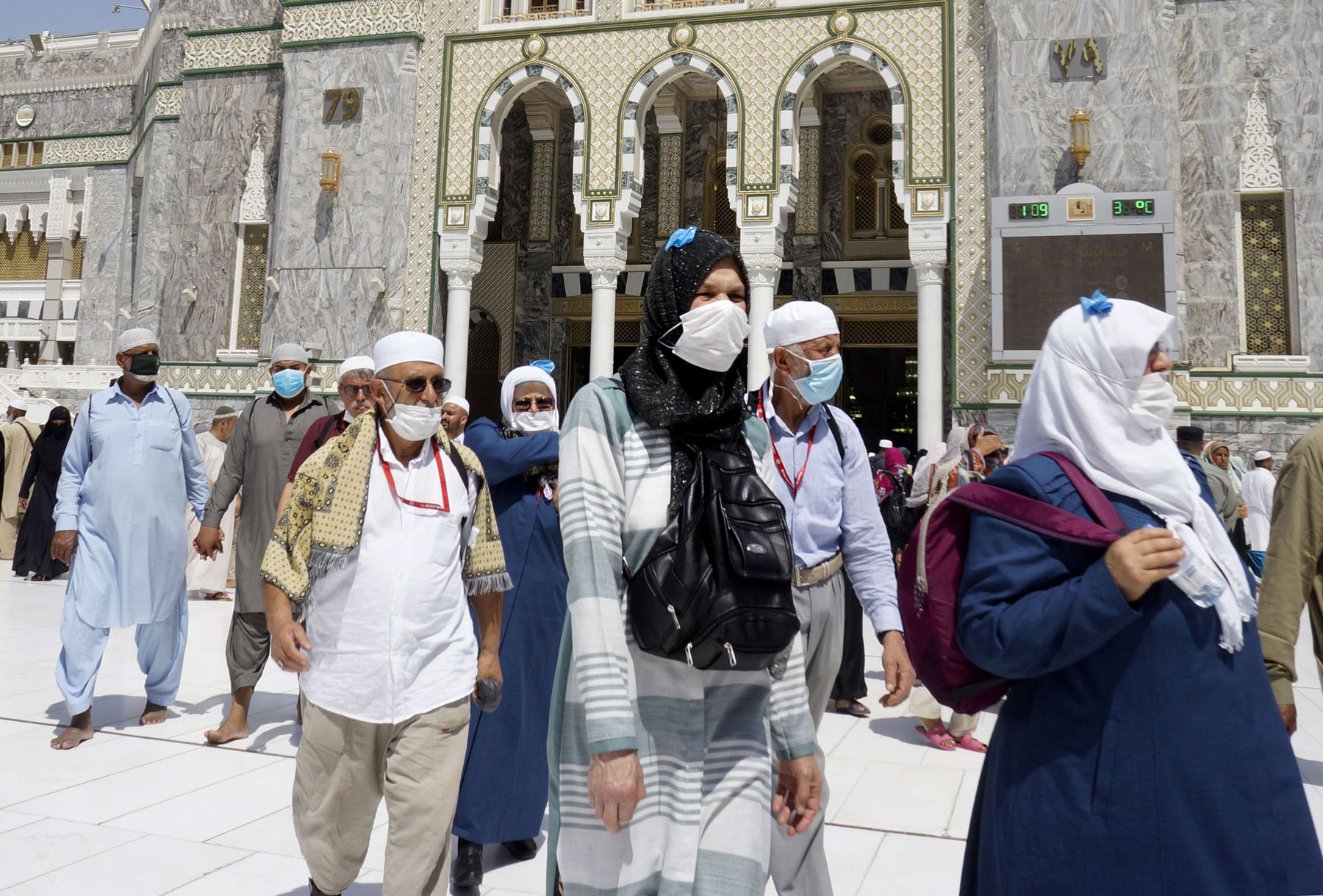 Muslim worshippers wear masks after the noon prayers outside the Grand Mosque, in the Muslim holy city of Mecca, Saudi Arabia, Saturday, March 7. (AP)