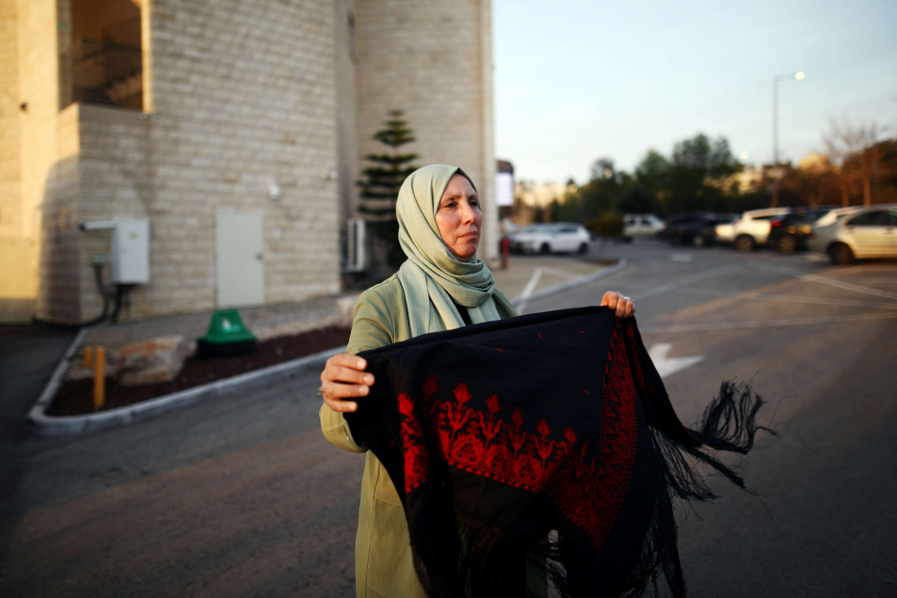 Incoming lawmaker Iman Khatib Yasin holds a Palestinian scarf in Nazareth after her Arab Joint List's results in Israeli elections. (Reuters)