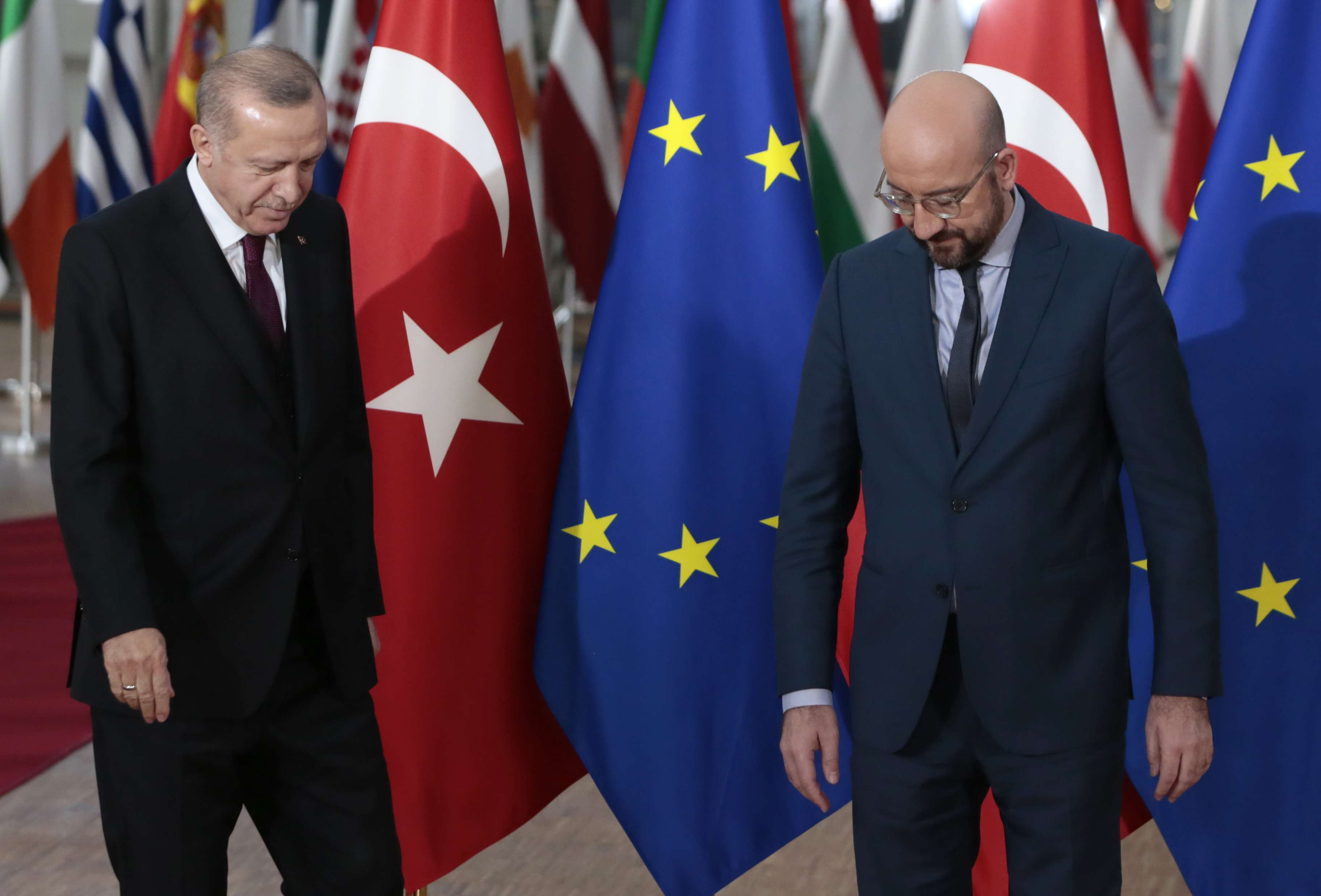 Turkish President Recep Tayyip Erdogan, left, stands with European Council President Charles Michel. (AP)