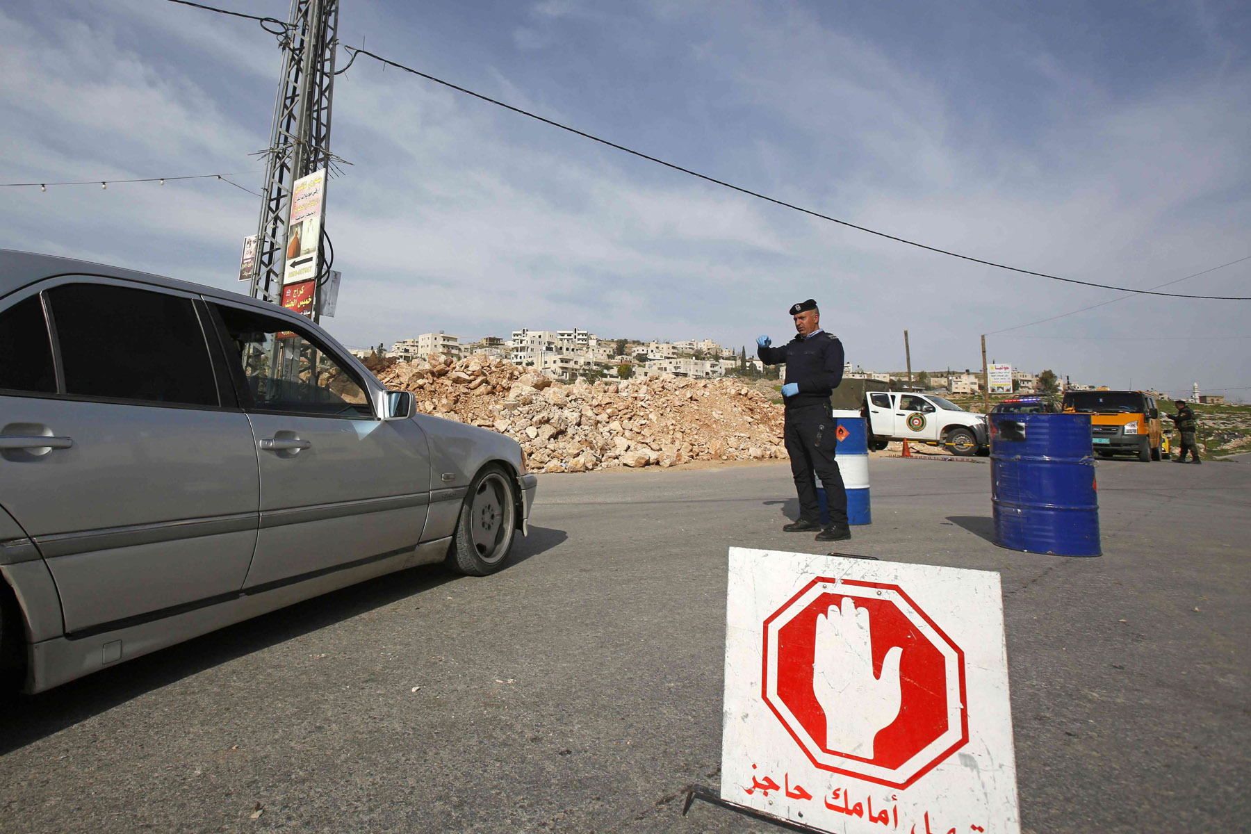 Palestinian security forces man a checkpoint in the West Bank city of Bethlehem, currently under lockdown due to coronavirus, March 10. (AFP)