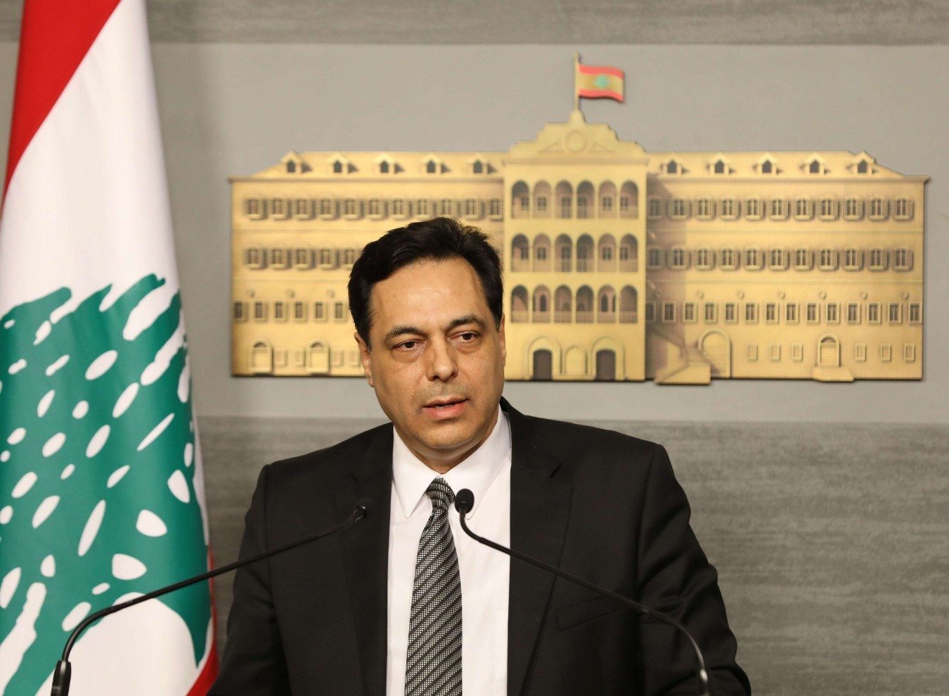 A handout picture provided by the Lebanese photo agency Dalati and Nohra on March 11, 2020 shows Prime Minister HassanDiab delivering a statement at the governmental palace in the capital Beirut. (AFP)