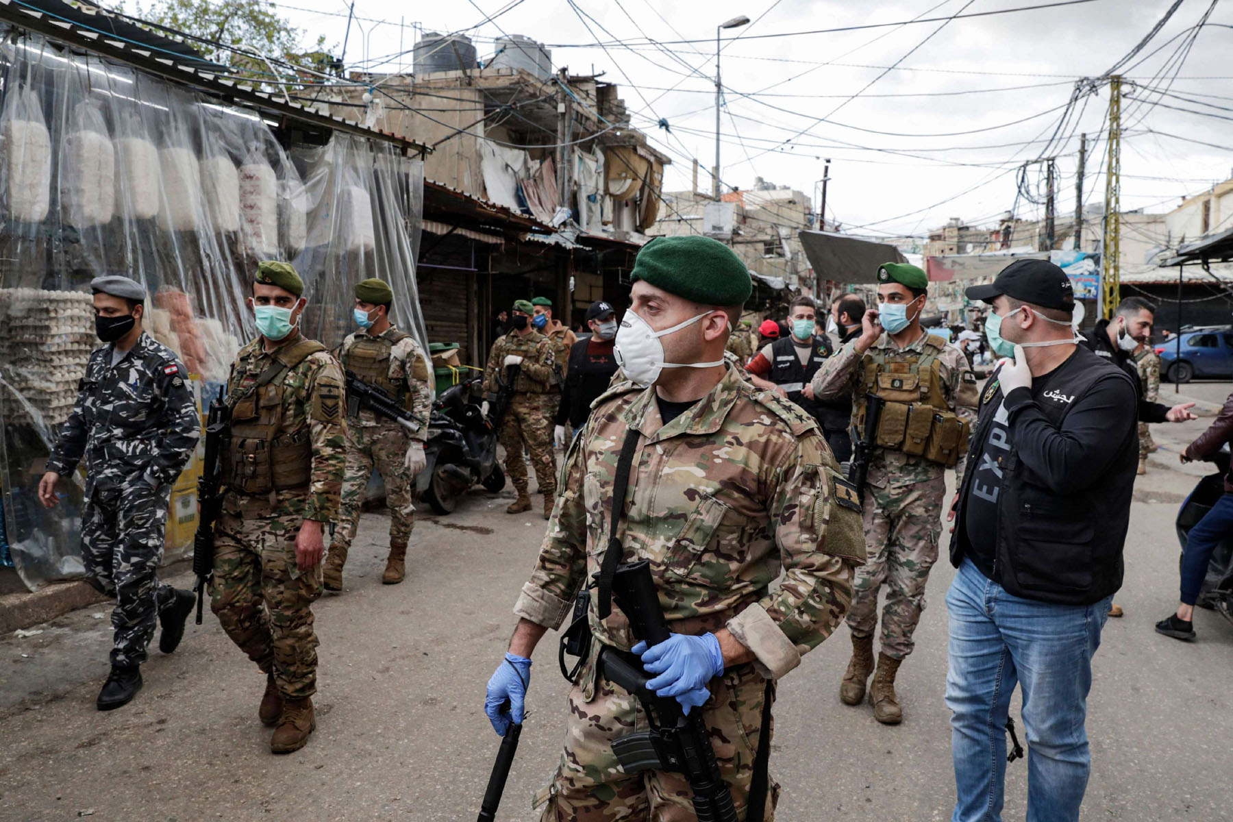 Lebanese Army soldiers patrol in the market of the Palestinian refugee camp of Sabra, south of Beirut. (AFP)