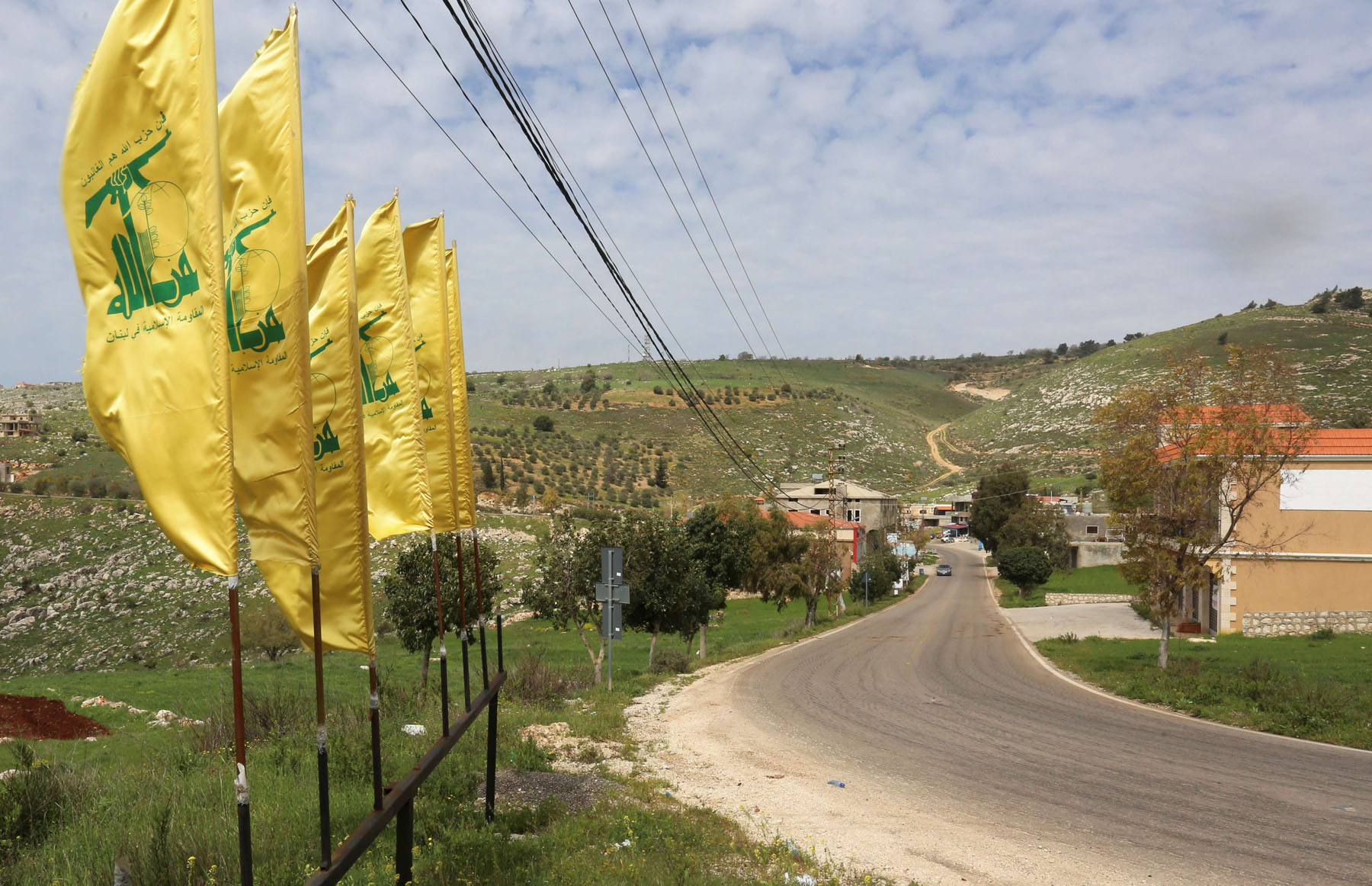 Hezbollah flags at the entrance of Mays Al-Jabal village, Lebanon. (AFP)