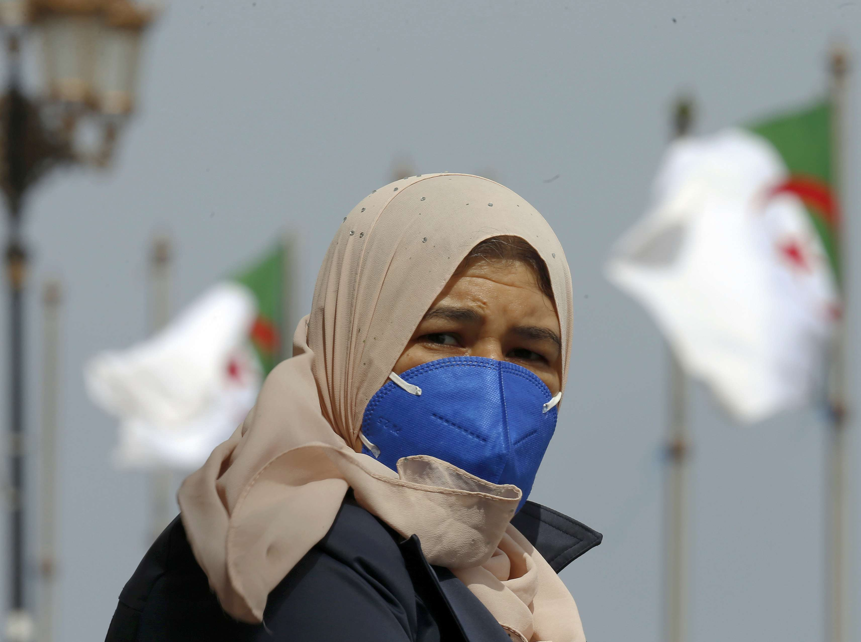An Algerian woman wears a protective mask amid pandemic in Algiers. (AP)