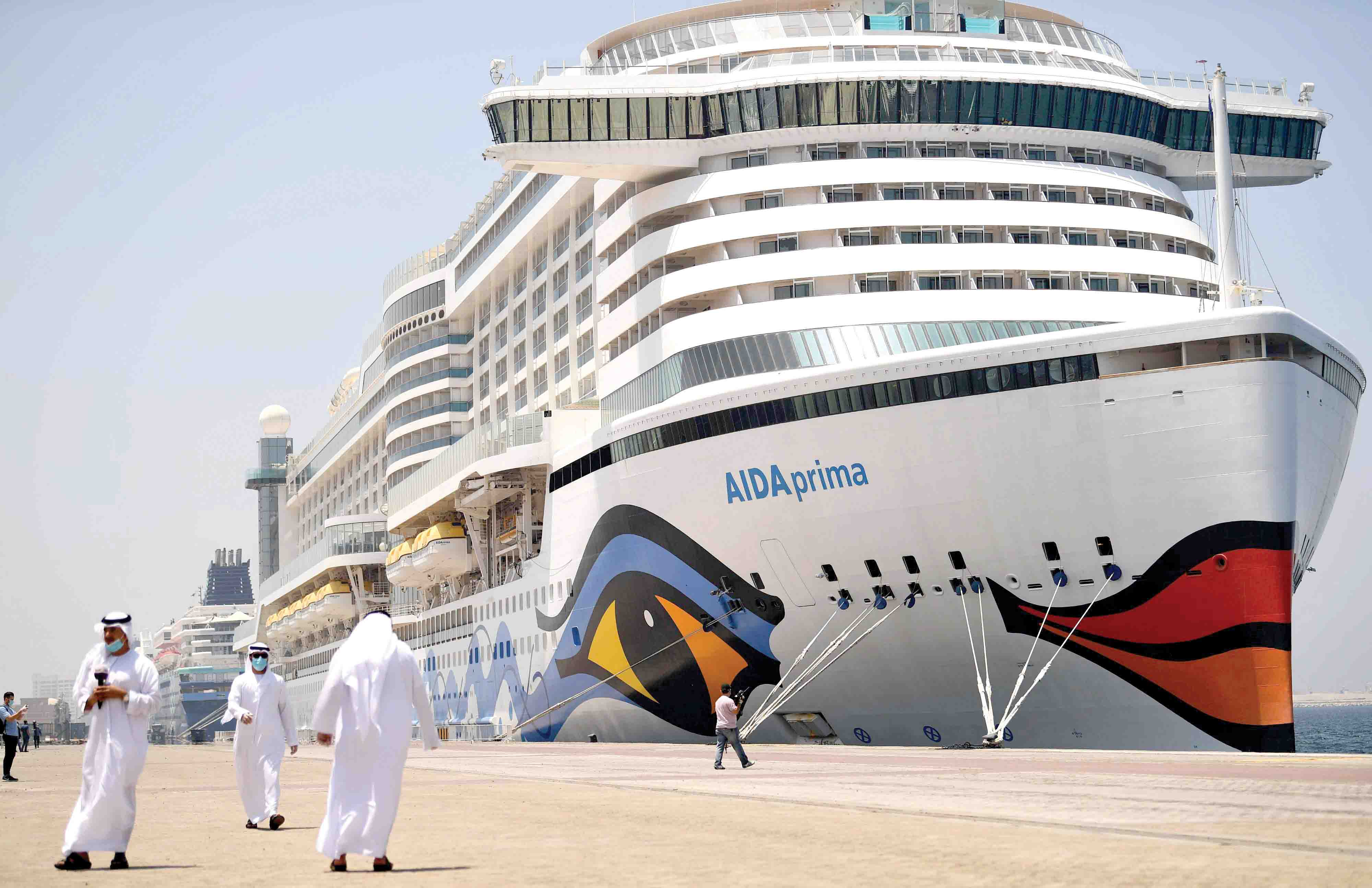 AIDA Prima, the flagship of AIDA Cruises, docks at Port Rashid in Dubai, April 22. Dubai has welcomed 13 foreign cruise ships that were at sea while most countries closed maritime borders due to the coronavirus pandemic. (AFP)