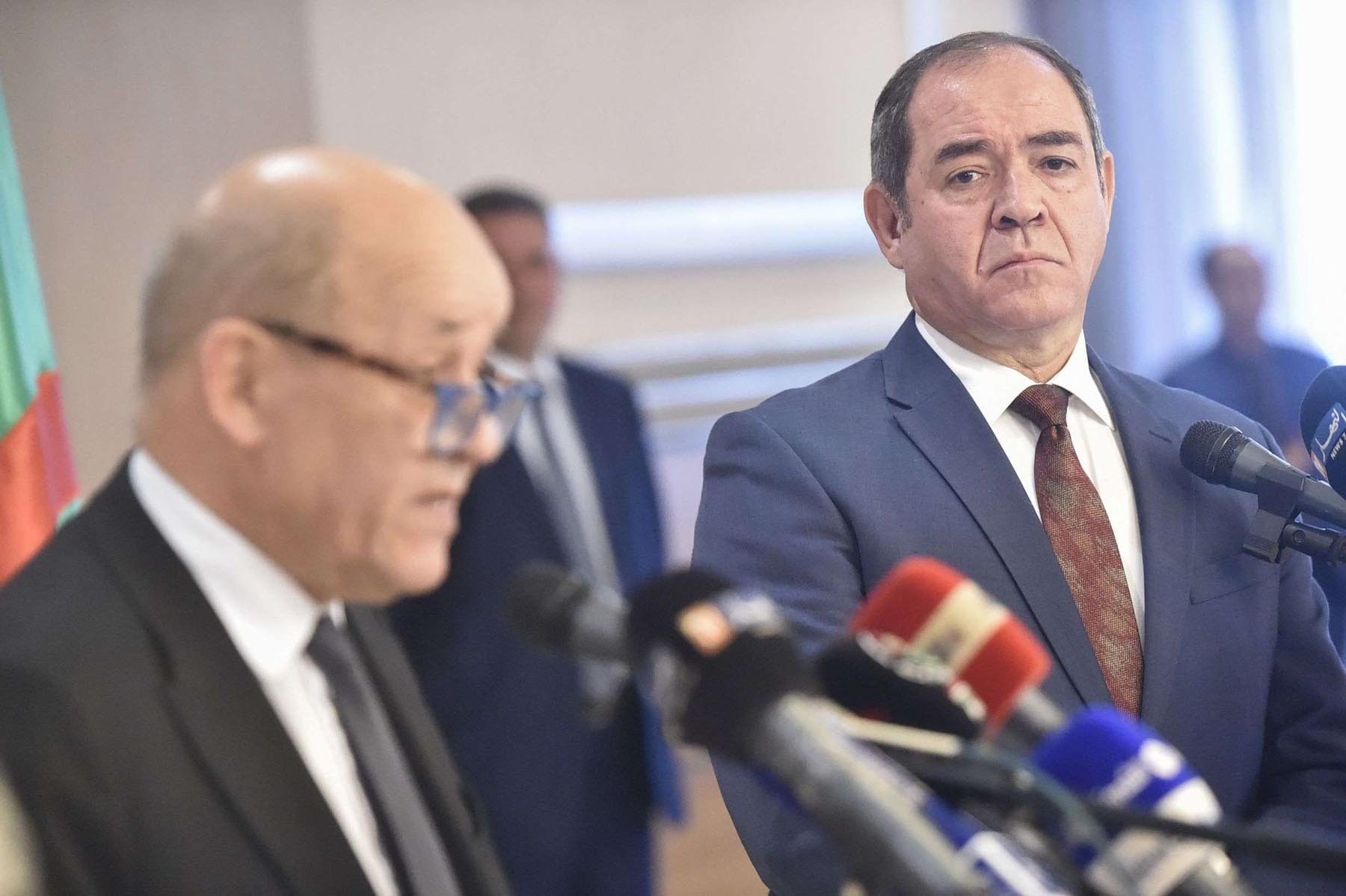 Algerian Foreign Minister Sabri Boukadoum (R) listens to his French counterpart Jean-Yves Le Drian during a joint press conference in the capital Algiers, last January. (AFP)