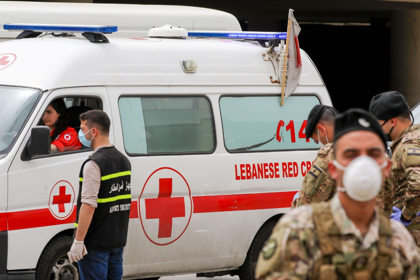 A Lebanese Red Cross vehicle arrives at the Beirut international airport, April 5. (AFP)