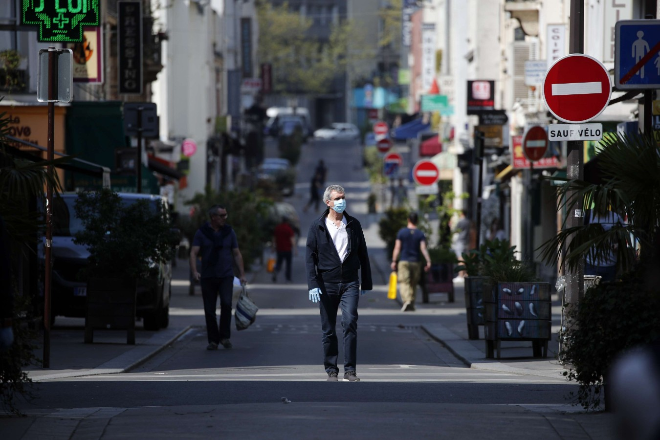 A man wearing protective mask walks in the middle of the street in Paris Friday April 10, 2020, during a nationwide confinement to counter the COVID-19. (AP)