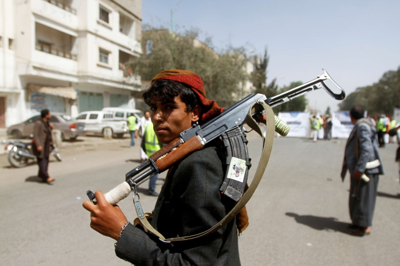 A Houthi supporter looks on as he carries a weapon during a gathering in Sana'a, Yemen April 2. (Reuters)