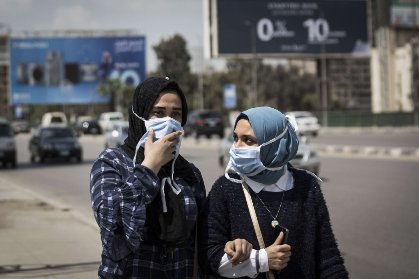 Women are seen wearing face masks as they walk over a bridge amid rising concerns over the Coronavirus (Covid-19) outbreak in Cairo, Egypt, April 1. (dpa)