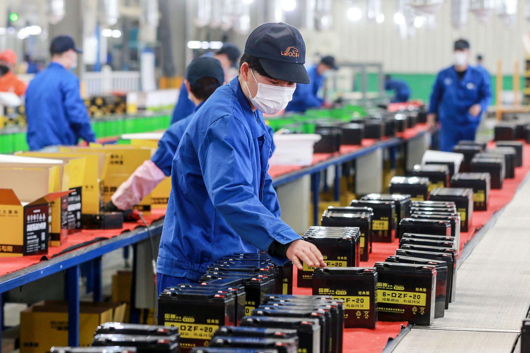 A Chinese employee working on a battery production line at a factory in Huaibei in China's Anhui province.(AFP)
