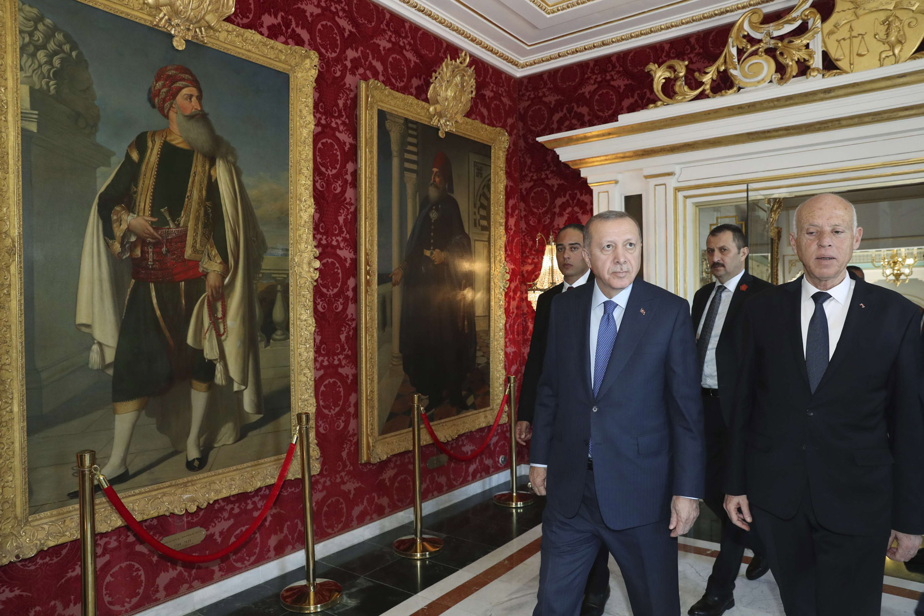 Out of step. Turkey's President Recep Tayyip Erdogan, left, and Tunisian President Kais Saied look at the paintings of former Tunisian rulers at the Carthage palace. (AFP)
