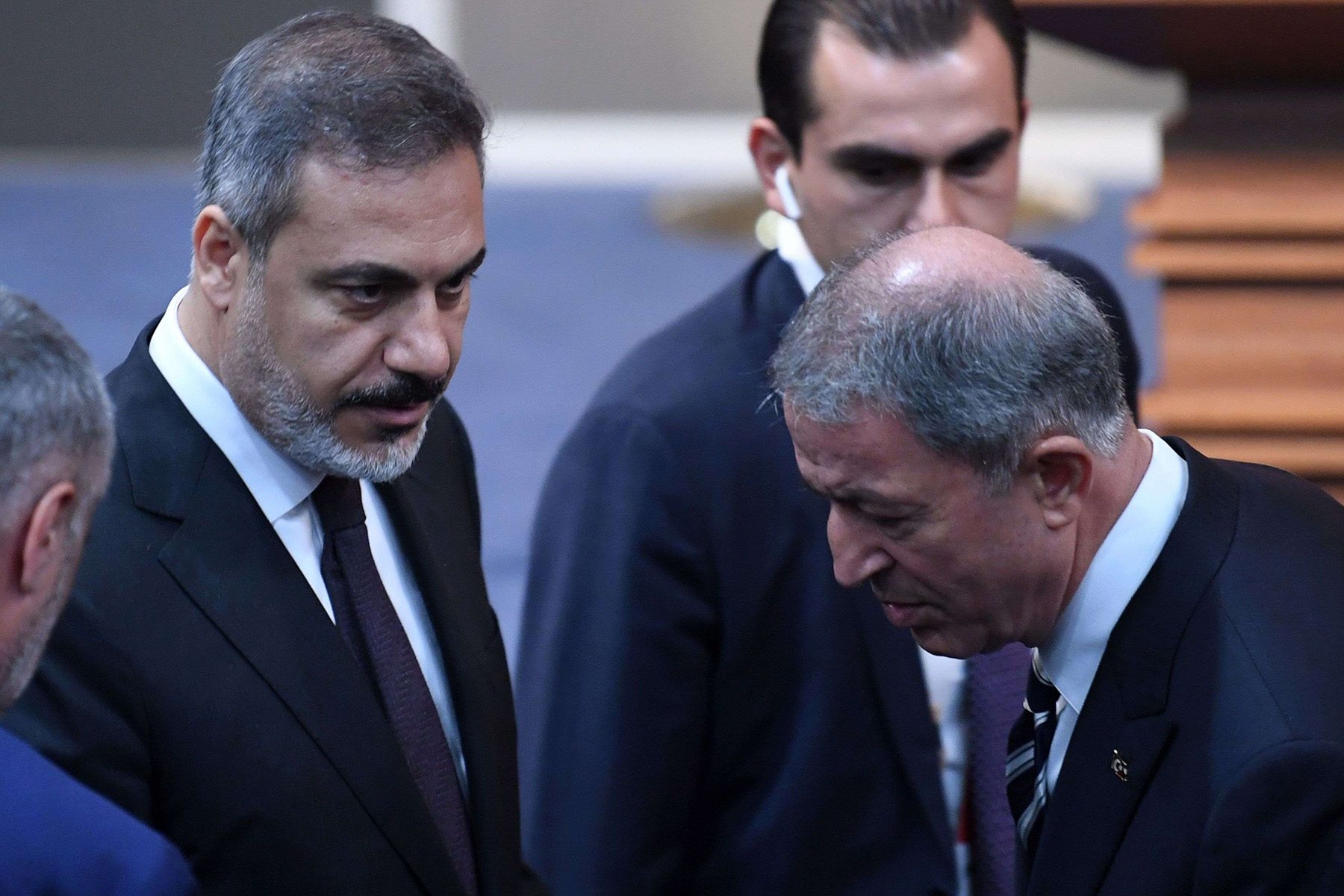 A 2018 file picture shows the head of Turkey's National Intelligence Organization (MIT) Hakan Fidan (L) attending a conference on Syria in Istanbul. (Reuters)