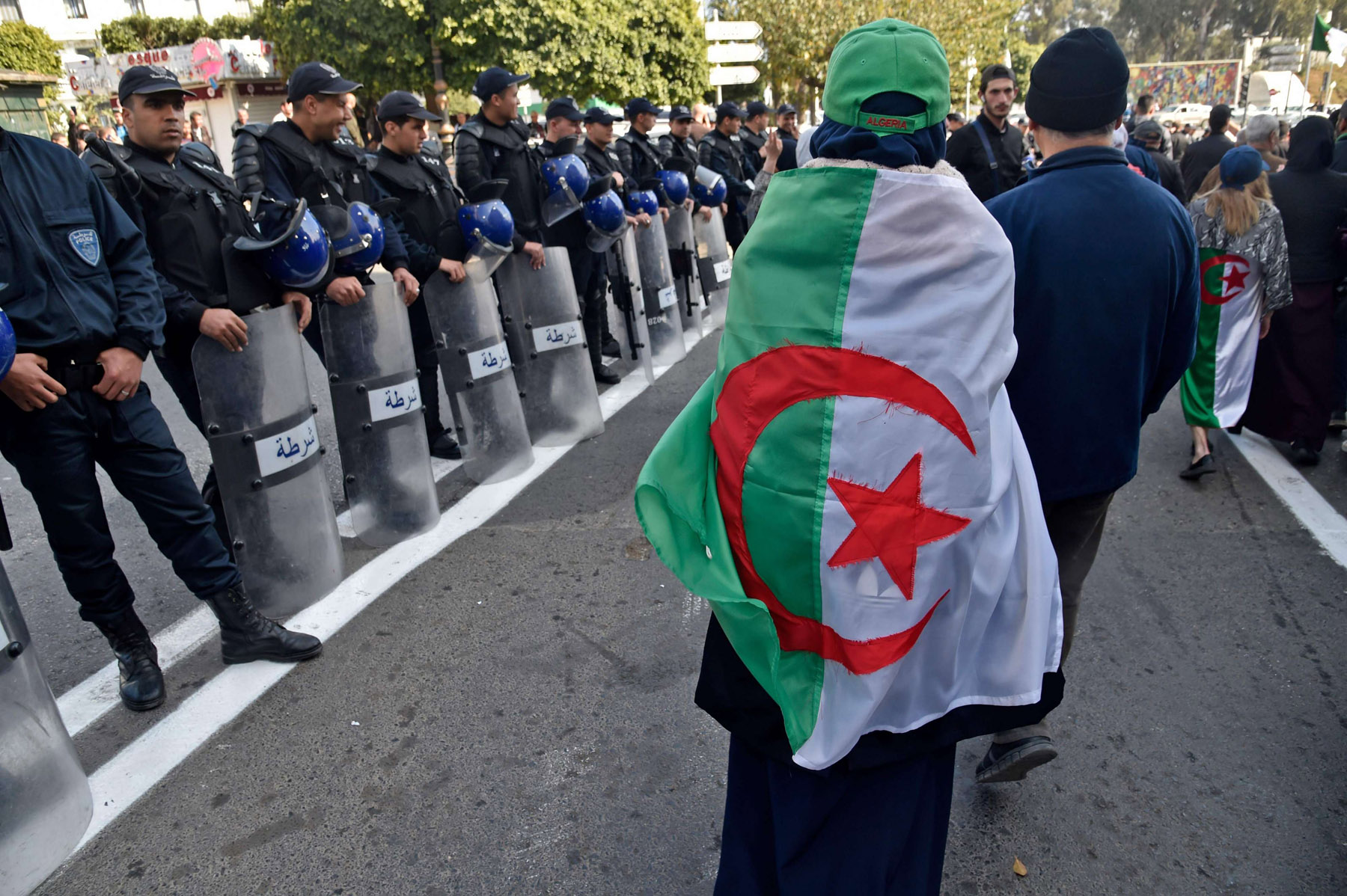 Algerian protesters take part in an anti-government demonstration in the capital Algiers, last February. (AFP)