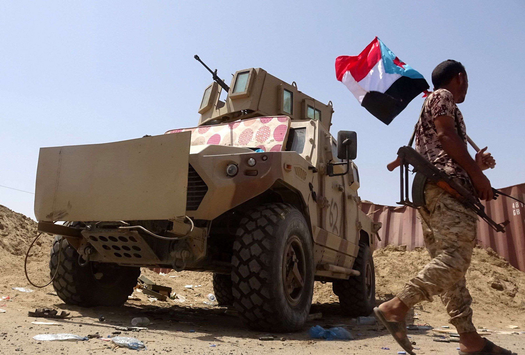 A fighter loyal to Yemen's separatist Southern Transitional Council (STC) holds the separatist flag in the southern Abyan province on May 18. (AFP)