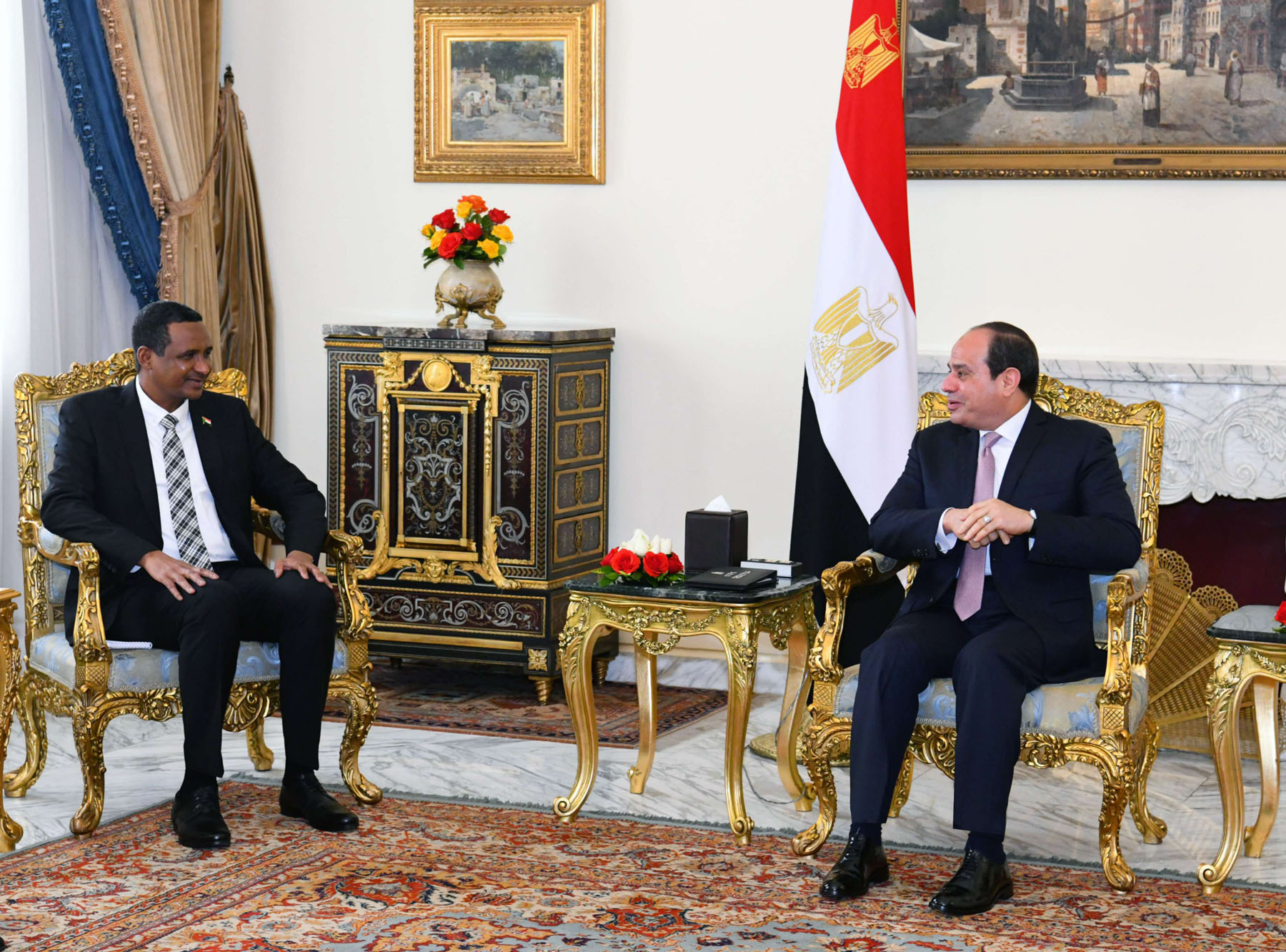 Egyptian President Abdel Fattah el-Sisi (R) meets with General Mohamed Hamdan Dagalo, Deputy Head of Sudan's Transitional Military Council (TMC), last March. (DPA)