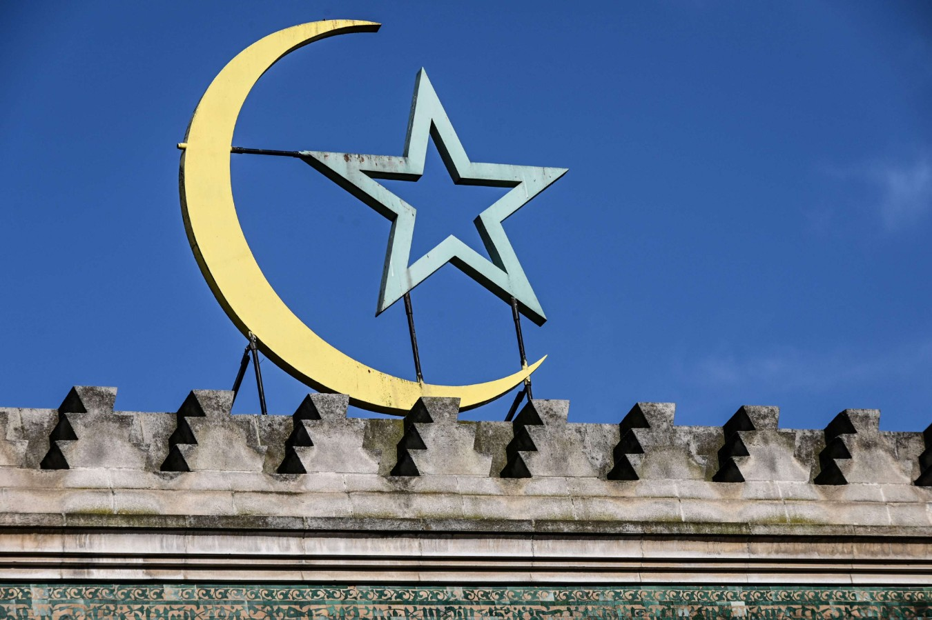 The Islamic symbol of the crescent and star atop the Great Mosque of Paris. (AFP)