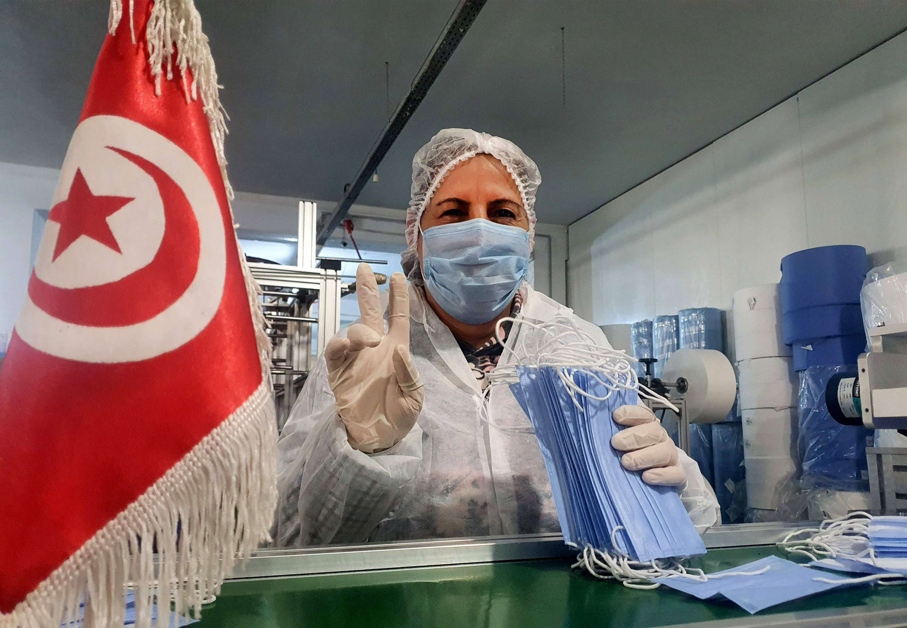 Tunisian woman works on the production of medical masks in a factory in the central city of Kairouan. (AFP)