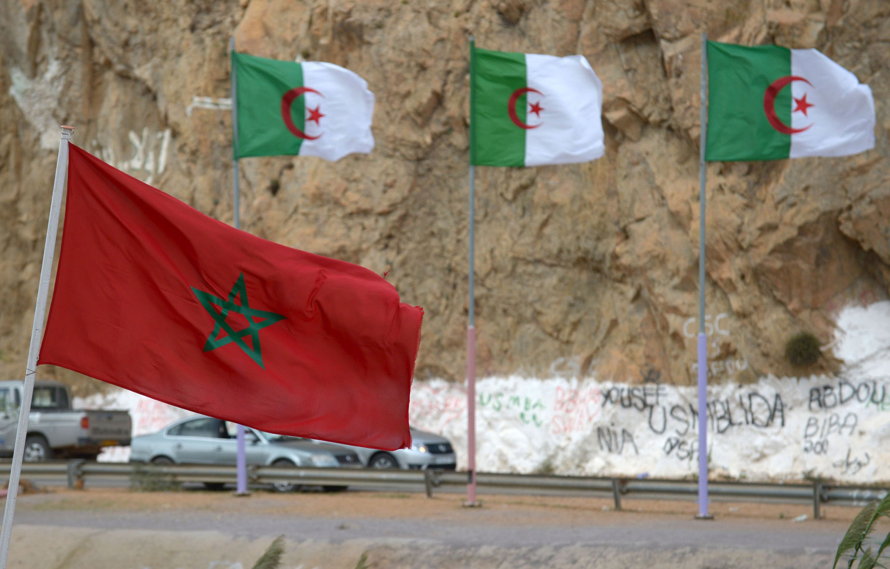 Moroccan and Algerian flags on the border between the two countries. (AFP)