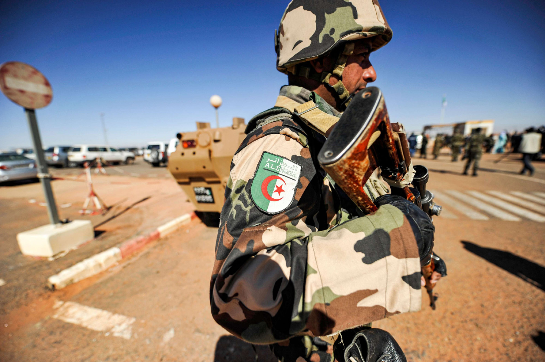 A 2013 file picture shows an Algerian soldier standing guard at the Tiguentourine gas complex, in In Amenas, about 1,600 kilometres southeast of the capital.  (AFP)