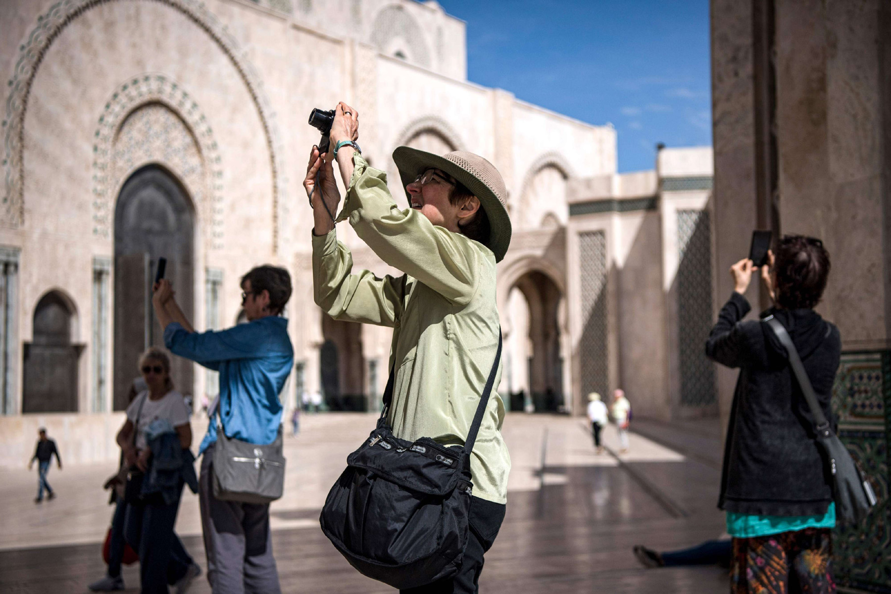 Tourists take pictures while visiting the Hassan II Grand Mosque in Morocco's Casablanca, last March. (AFP)
