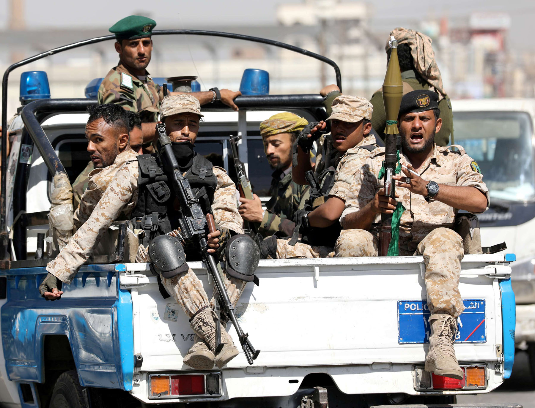 A file picture of Houthi troops riding on the back of a police patrol truck in Sana'a. (REUTERS)