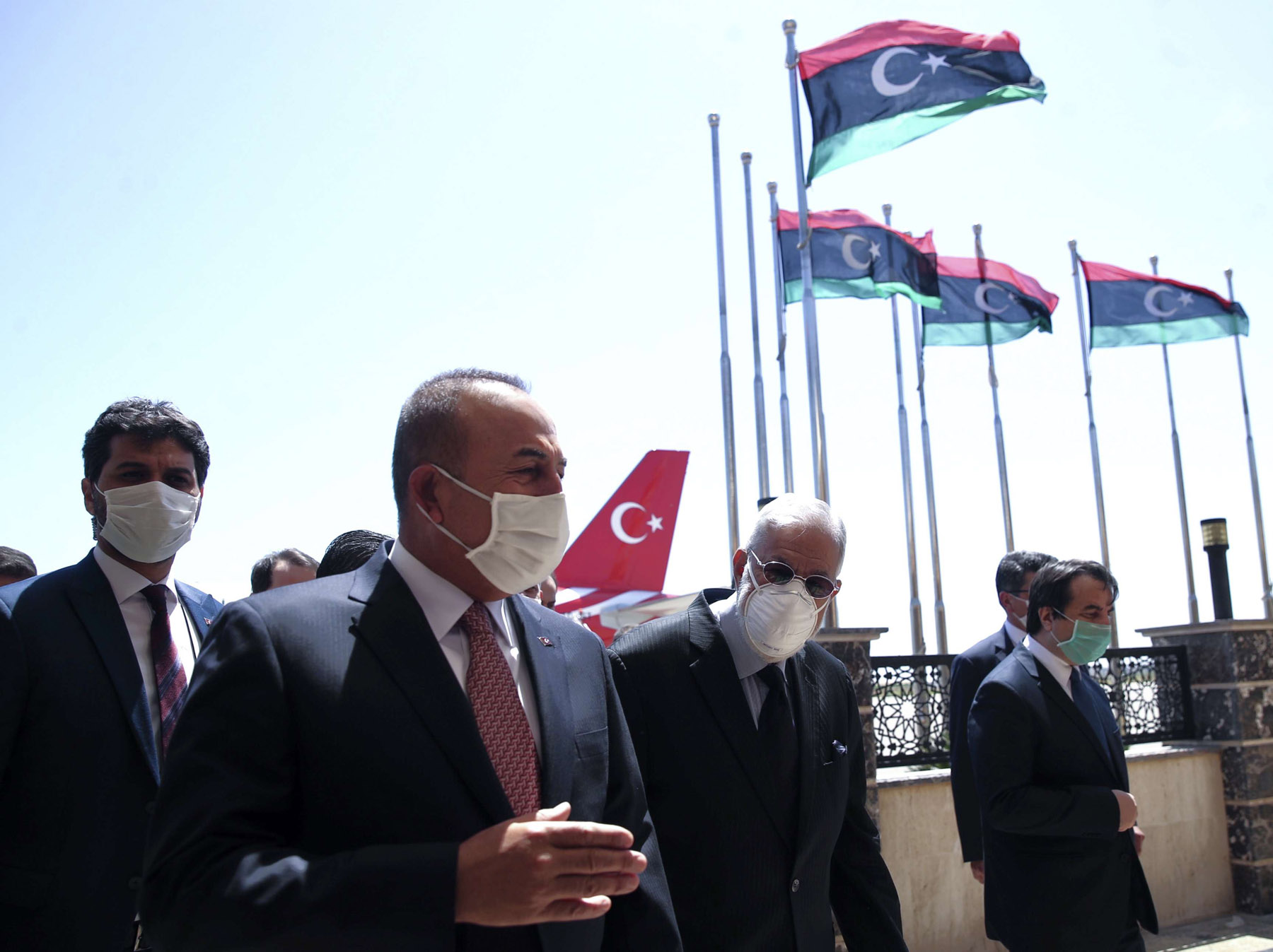 Turkish Foreign Minister Mevlut Cavusoglu, left, and Muhammed Tahir Siyala, Foreign Minister of the Tripoli-based Government of National Accord (GNA), at the airport in Tripoli,  June 17. (AP)