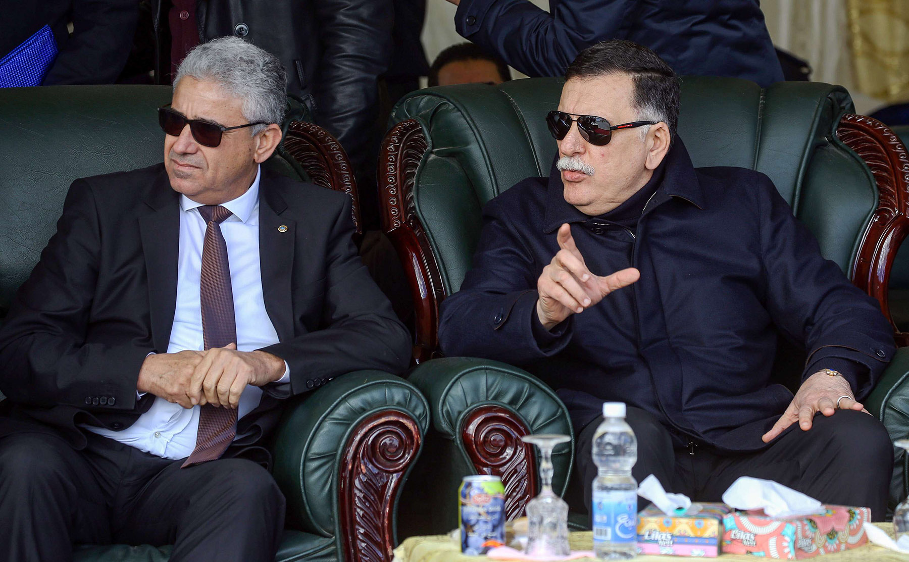 A 2019 file picture shows GNA's Prime Minister Fayez al-Sarraj (R) speaking with Interior Minister Fathi Bashagha (L) in Tripoli. (AFP)