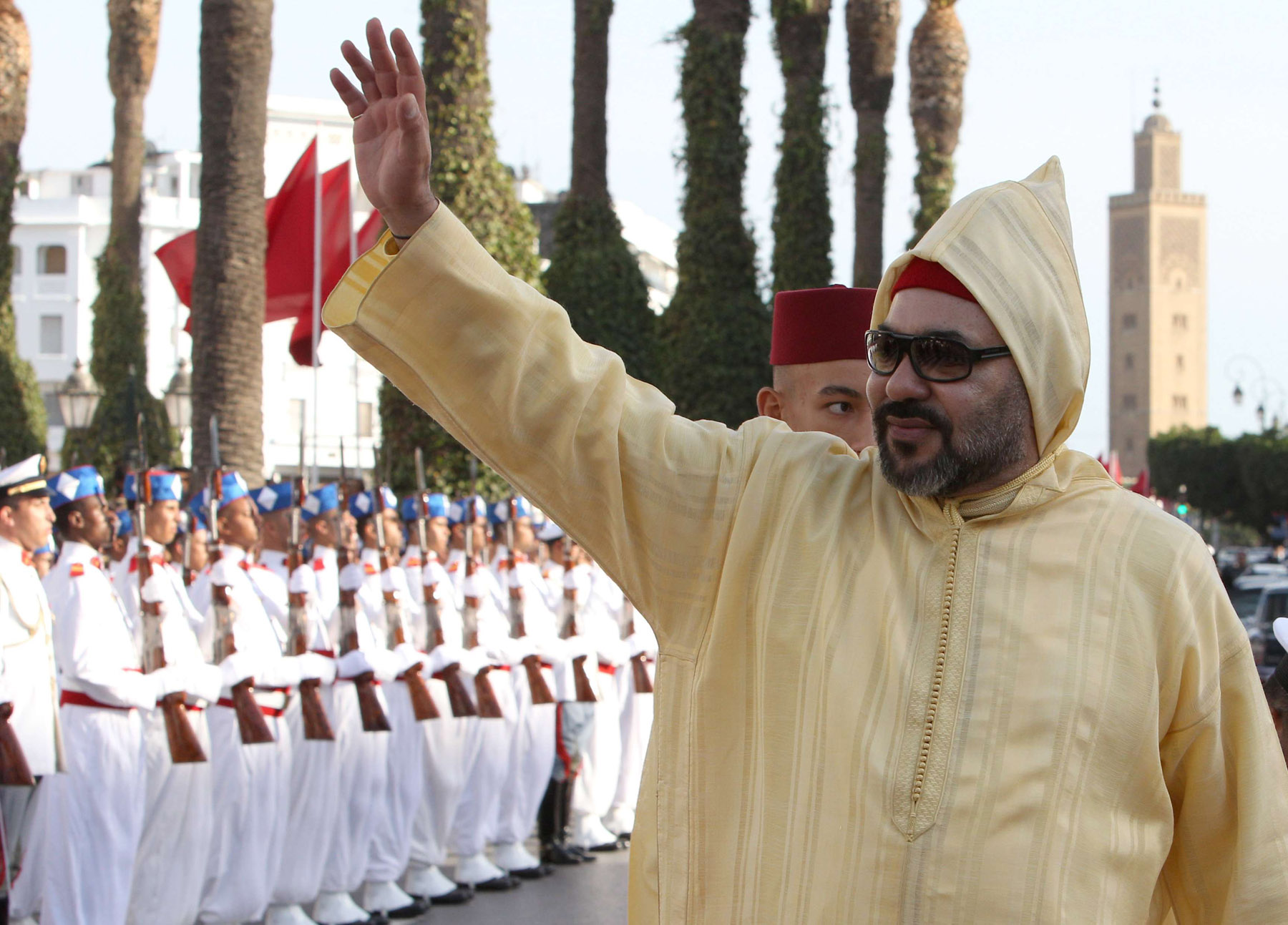 A 2018 file picture shows Moroccan King Mohammed VI waving to the crowd as he arrives to the the opening session in the Morocco Parliament in Rabat. (AFP)
