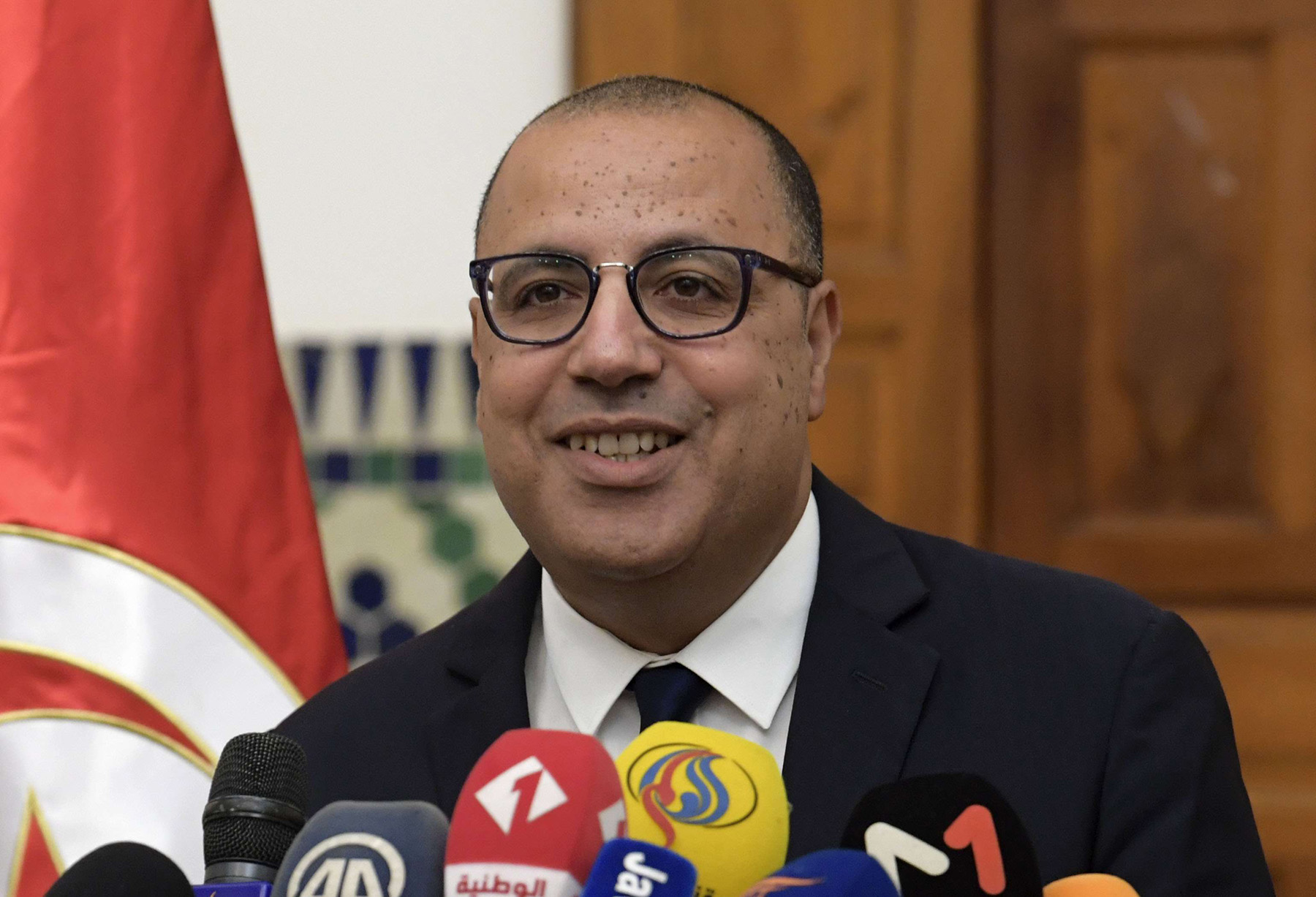 Tunisia's Prime Minister-designate Hichem Mechichi briefs the media about his government formation process in Carthage, on August 10, 2020.( AFP)