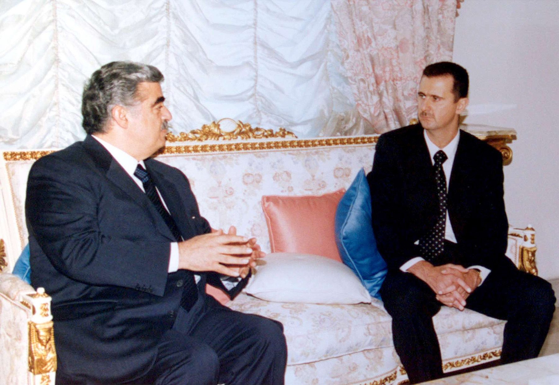 A file picture shows Syrian President Bashar al-Assad meeting with Rafik al-Hariri in Damascus, in  June 2000. (REUTERS)